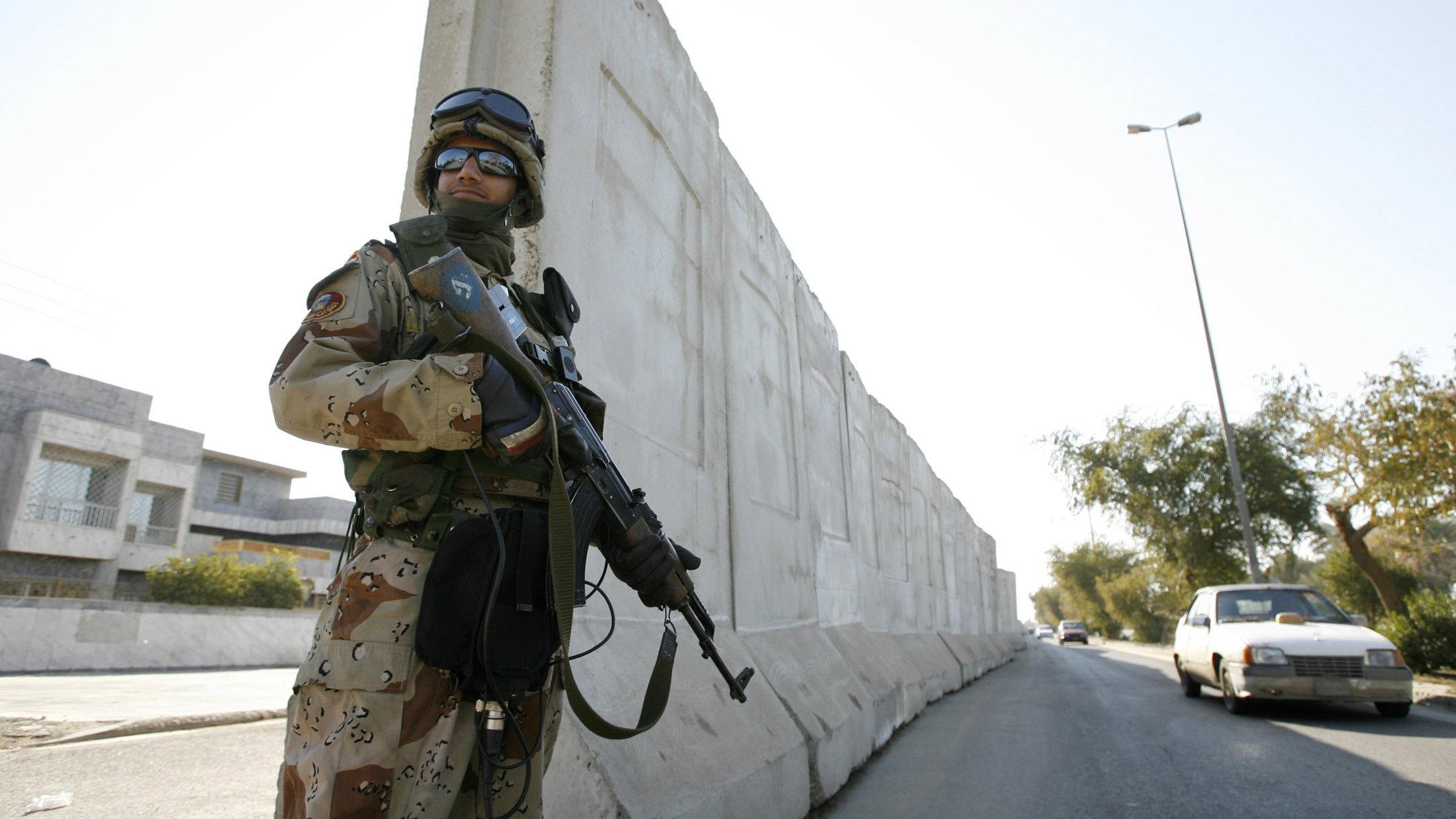 soldier near concrete wall