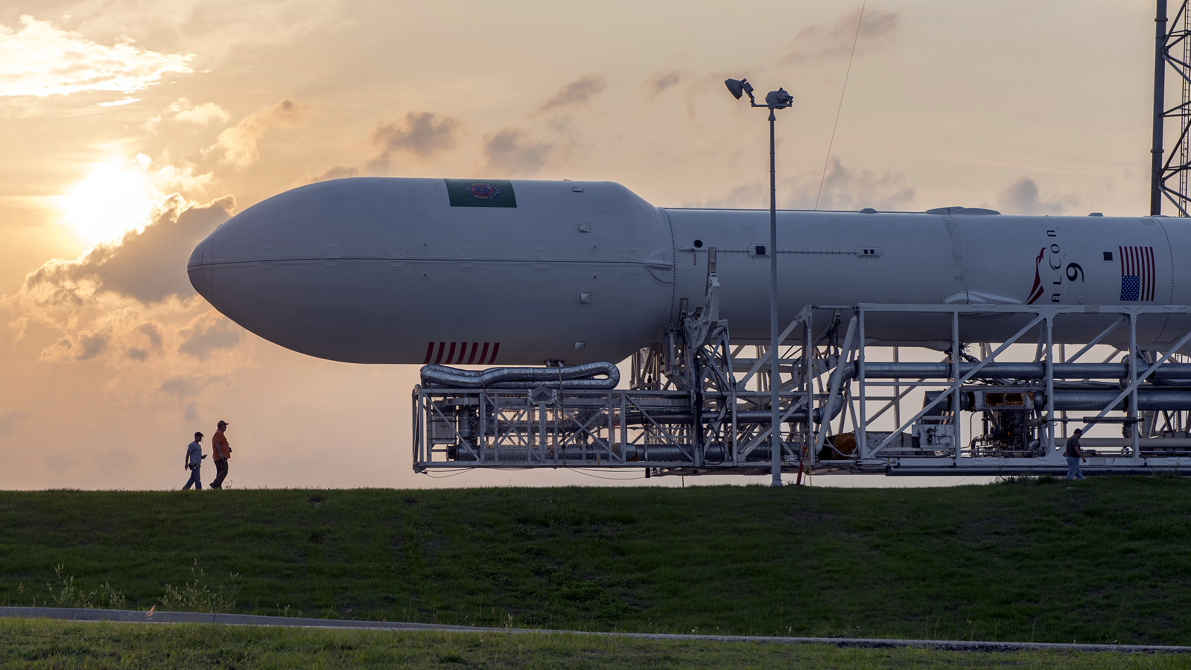 A SpaceX rocket is rolled out ahead of a 2014 launch.