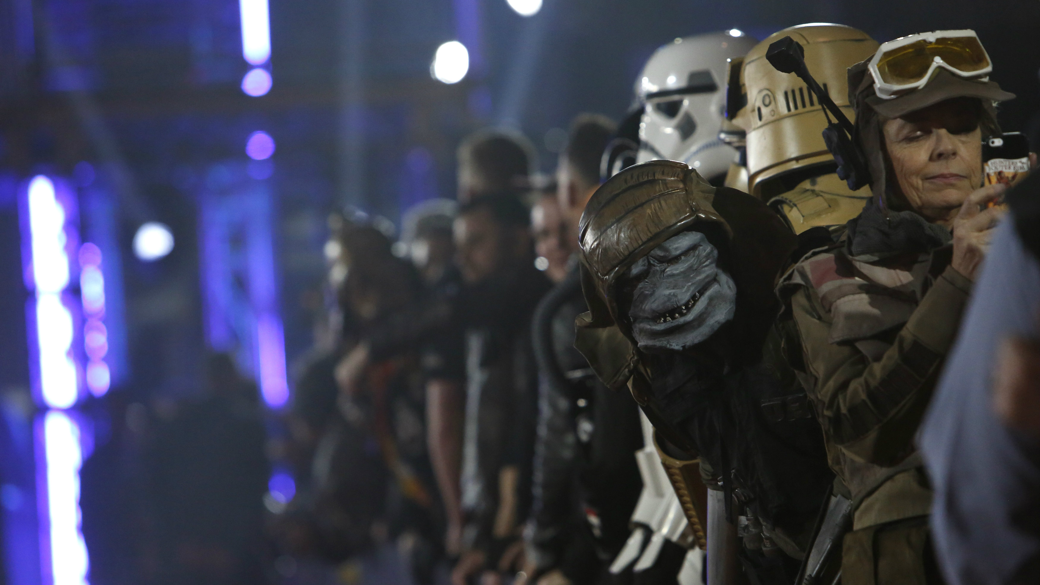 """General view of members of the crowd, some wearing costumes, as they await arrivals on the red carpet at the world premiere of the film """"Rogue One: A Star Wars Story"""" in Hollywood, California, U.S."""
