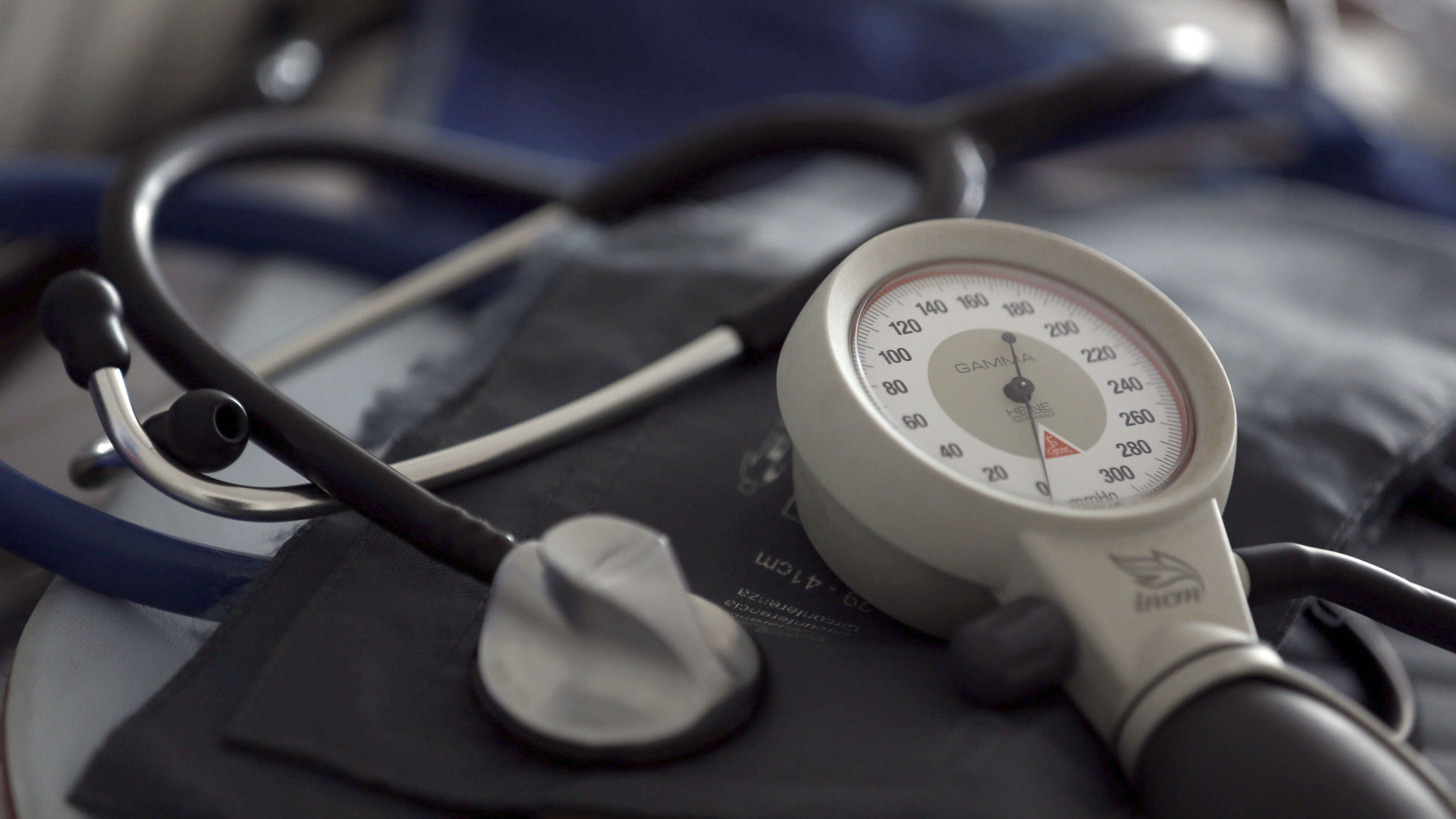 A stethoscope and blood pressure cuff on a table.