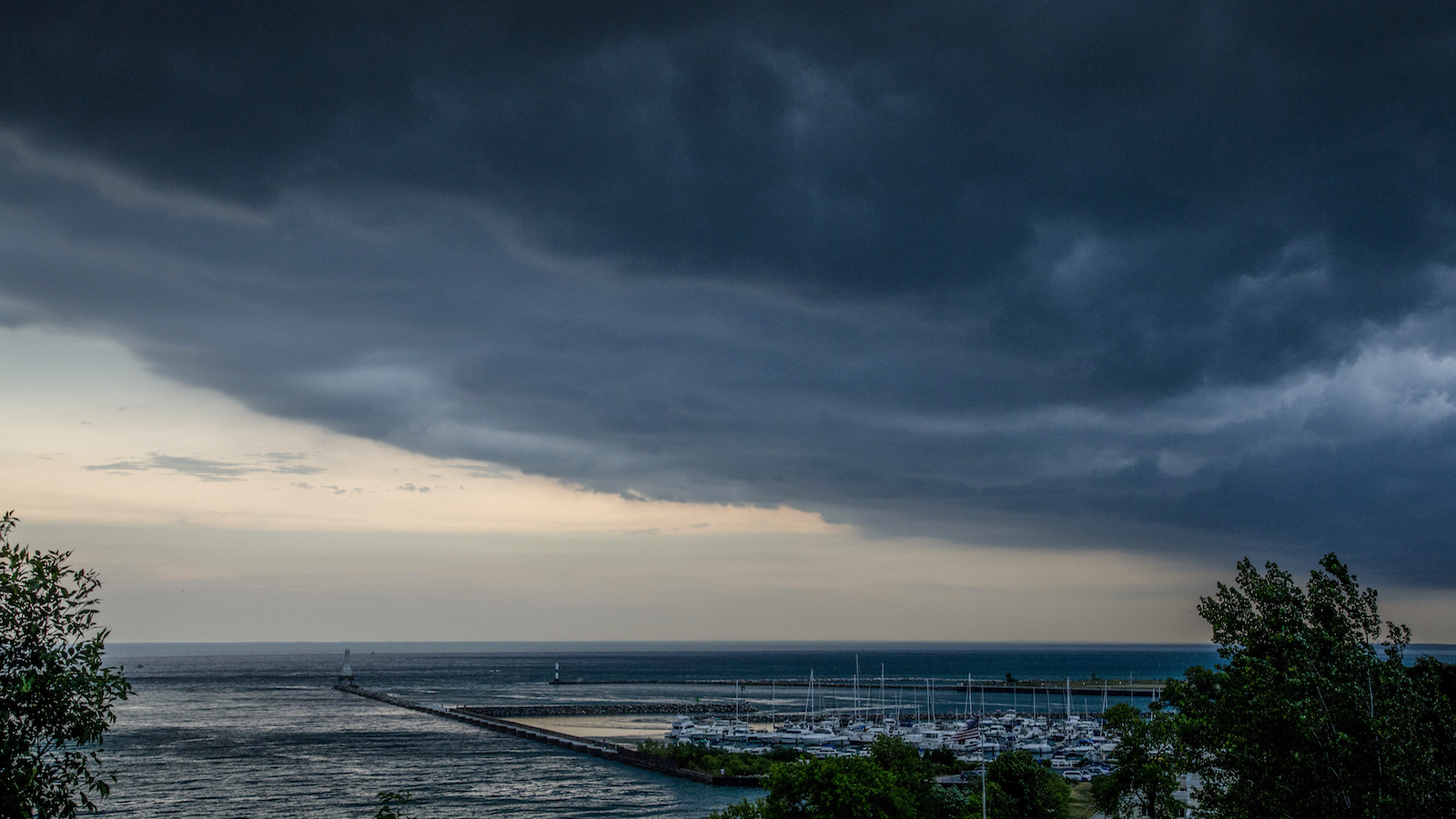 Storm clouds roll across the sky over the marina Thursday, July, 21, 2016 in Port Washington, Wi. (AP Photo/Jeffrey Phelps)