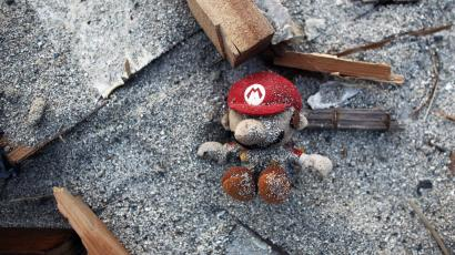 A Super Mario soft toy is seen among the ruins of the March 11 earthquake and tsunami in Yamada
