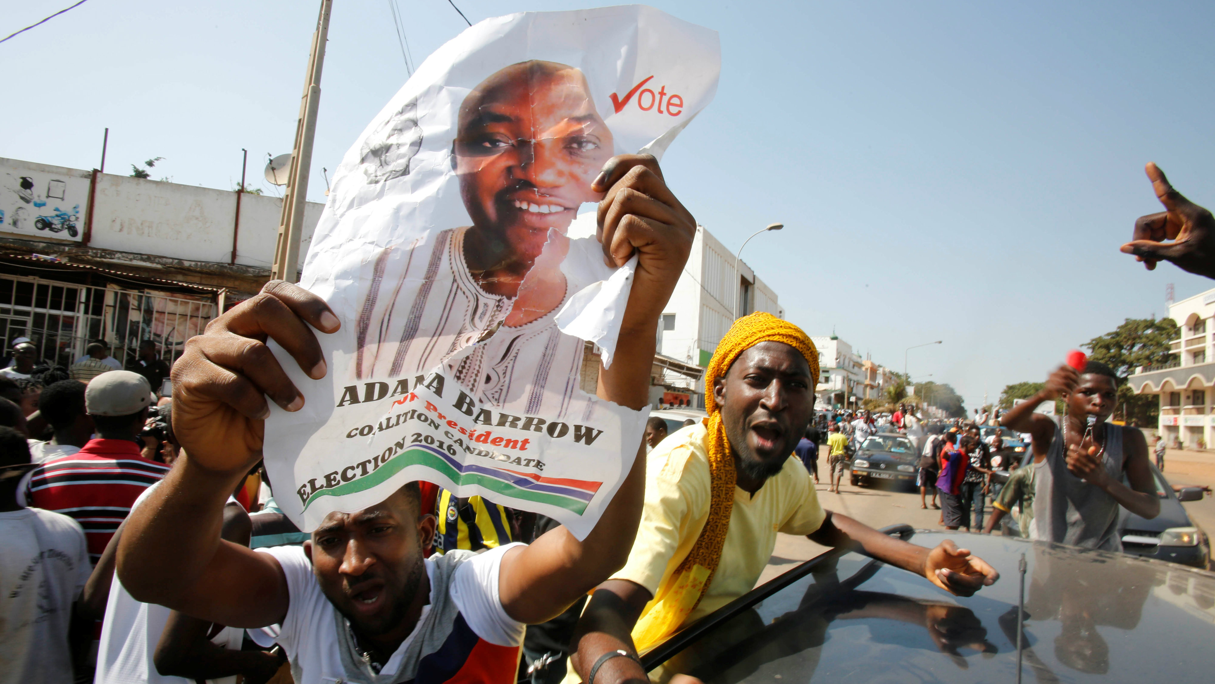 Supporters of president-elect Adama Barrow celebrate Barrow's election victory in Banjul, Gambia, December 2, 2016