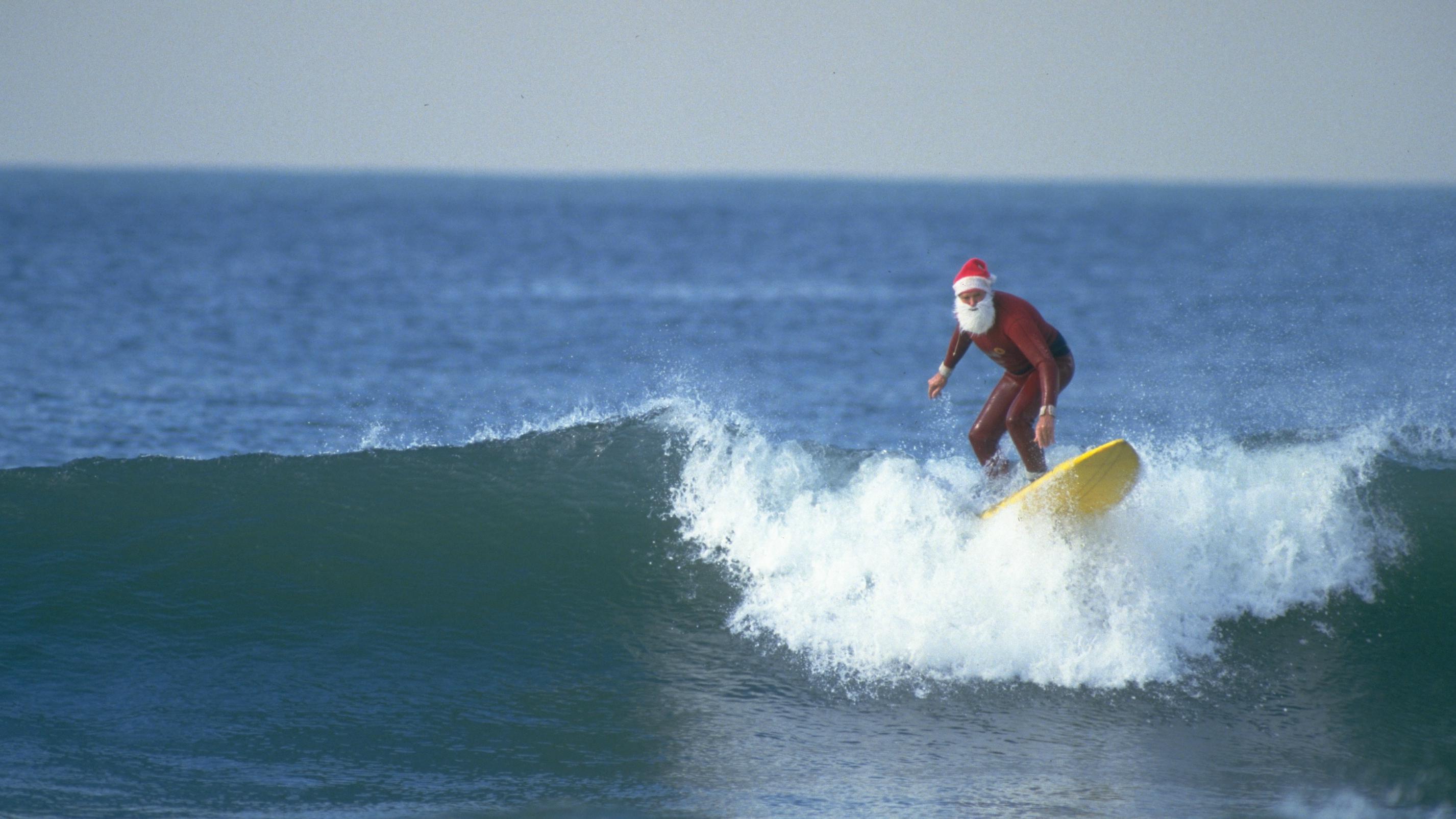 surfing-santa-claus