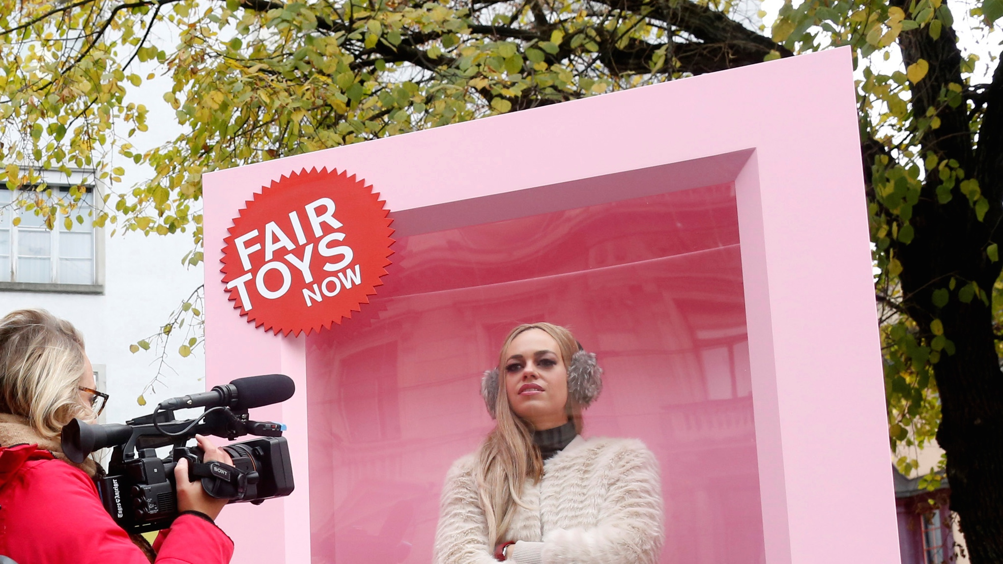 Woman pretends to be a doll in a box