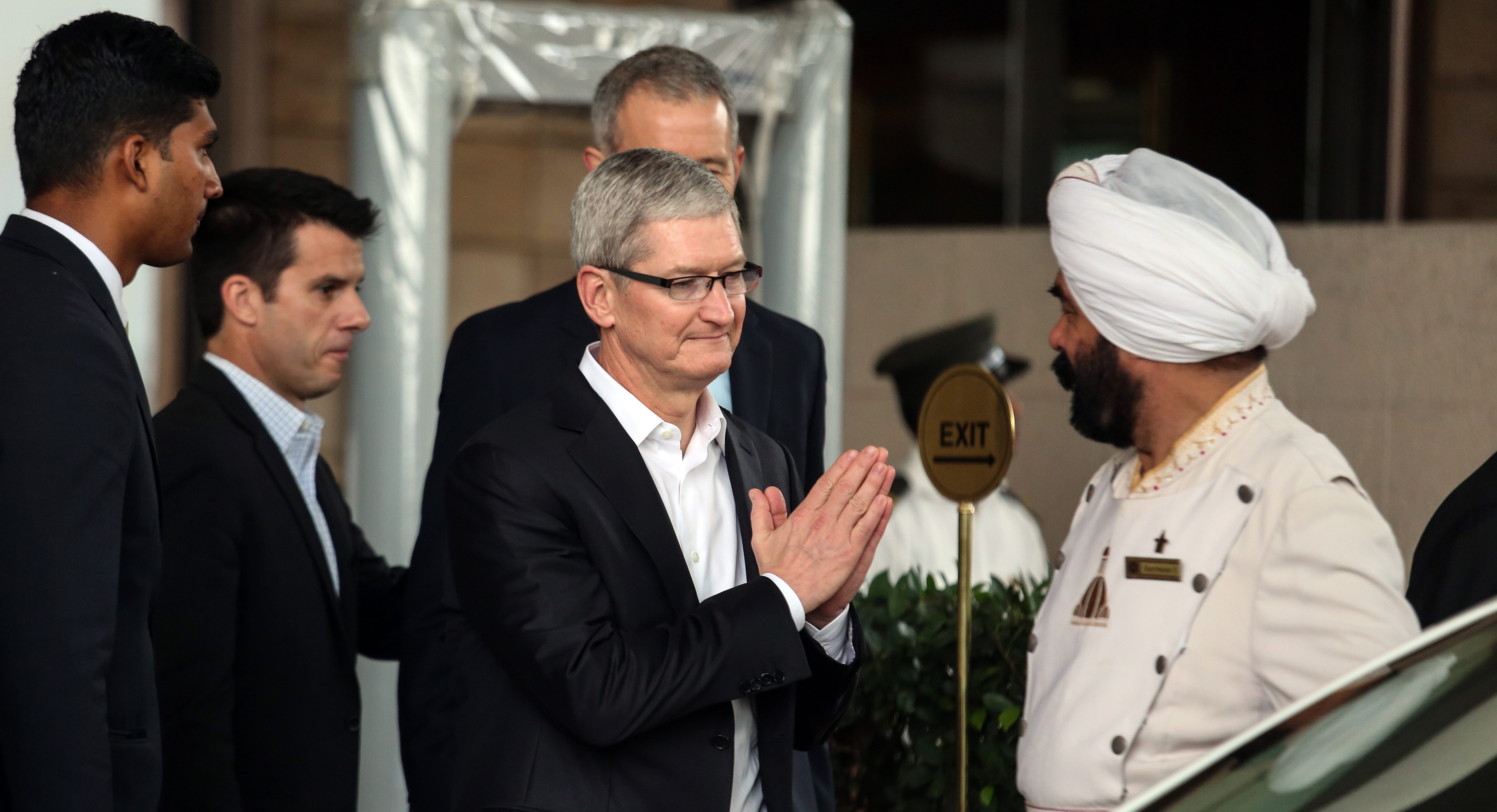 Apple Chief Executive Officer Tim Cook (C) leaves the city hotel in Mumbai, on the first day of his visit to India, 18 May 2016. According to reports Tim Cook is on a four day visit to India during which he will meet with Prime Minister Narendra Modi, Tata Group Chairman Cyrus Mistry and Indian film actor, Shah Rukh Khan.