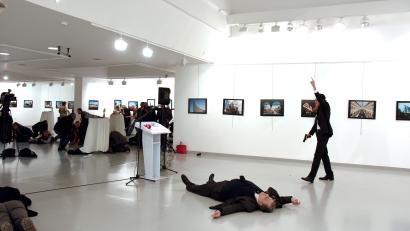 ATTENTION EDITORS - VISUAL COVERAGE OF SCENES OF DEATH Russian Ambassador to Turkey Andrei Karlov lies on the ground after he was shot by unidentified man at an art gallery in Ankara, Turkey, December 19, 2016. Depo Photos/Sozcu Newspaper via REUTERS ATTENTION EDITORS - THIS PICTURE WAS PROVIDED BY A THIRD PARTY. FOR EDITORIAL USE ONLY. NO RESALES. NO ARCHIVE. TURKEY OUT. NO COMMERCIAL OR EDITORIAL SALES IN TURKEY. TEMPLATE OUT - RTX2VQKB