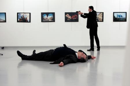 Russian Ambassador to Turkey Andrei Karlov lies on the ground after he was shot by Mevlut Mert Altintas at an art gallery in Ankara, Turkey on Dec.19,2016.
