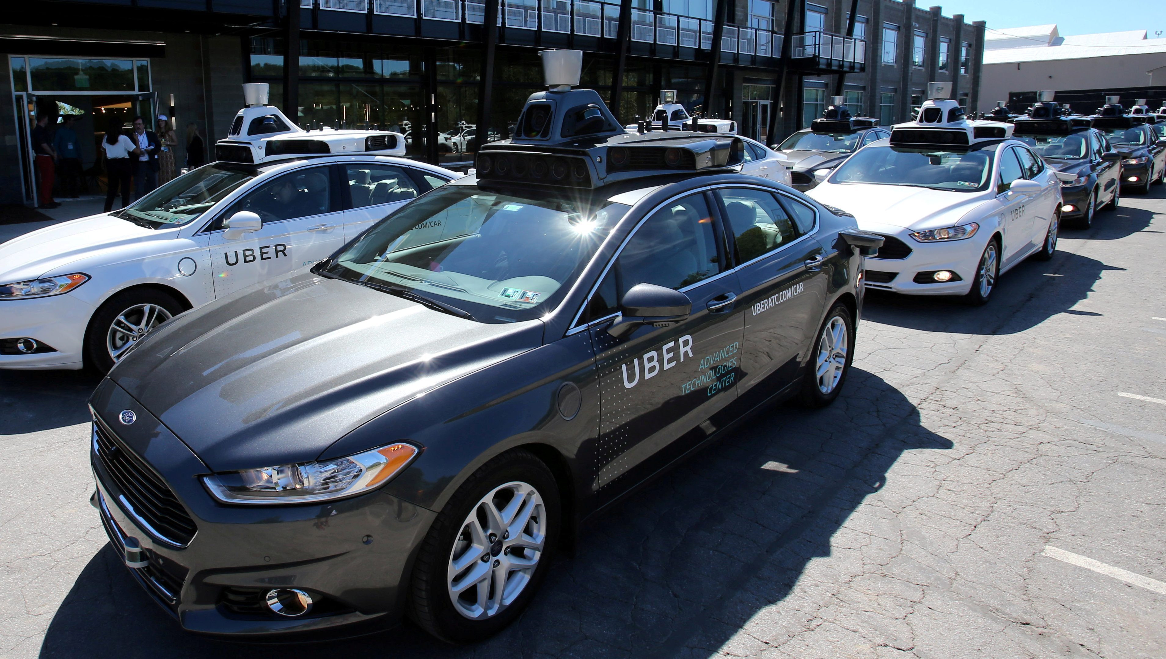 A fleet of Uber's Ford Fusion self driving cars are shown during a demonstration of self-driving automotive technology in Pittsburgh, U.S., September 13, 2016.     REUTERS/Aaron Josefczyk/File Photo - RTSUVJY