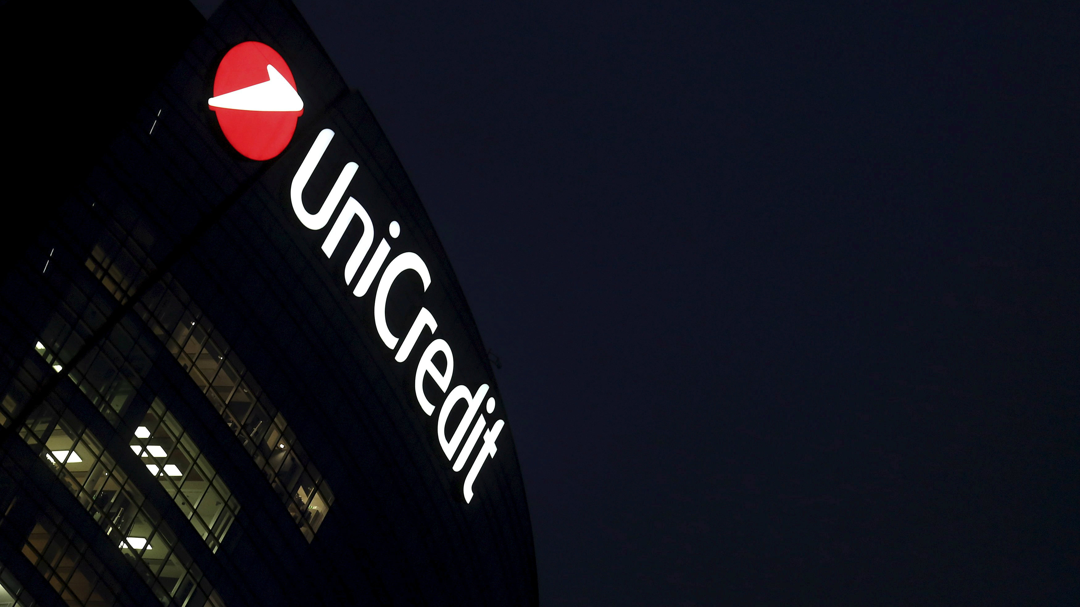 UniCredit building at night in Milan