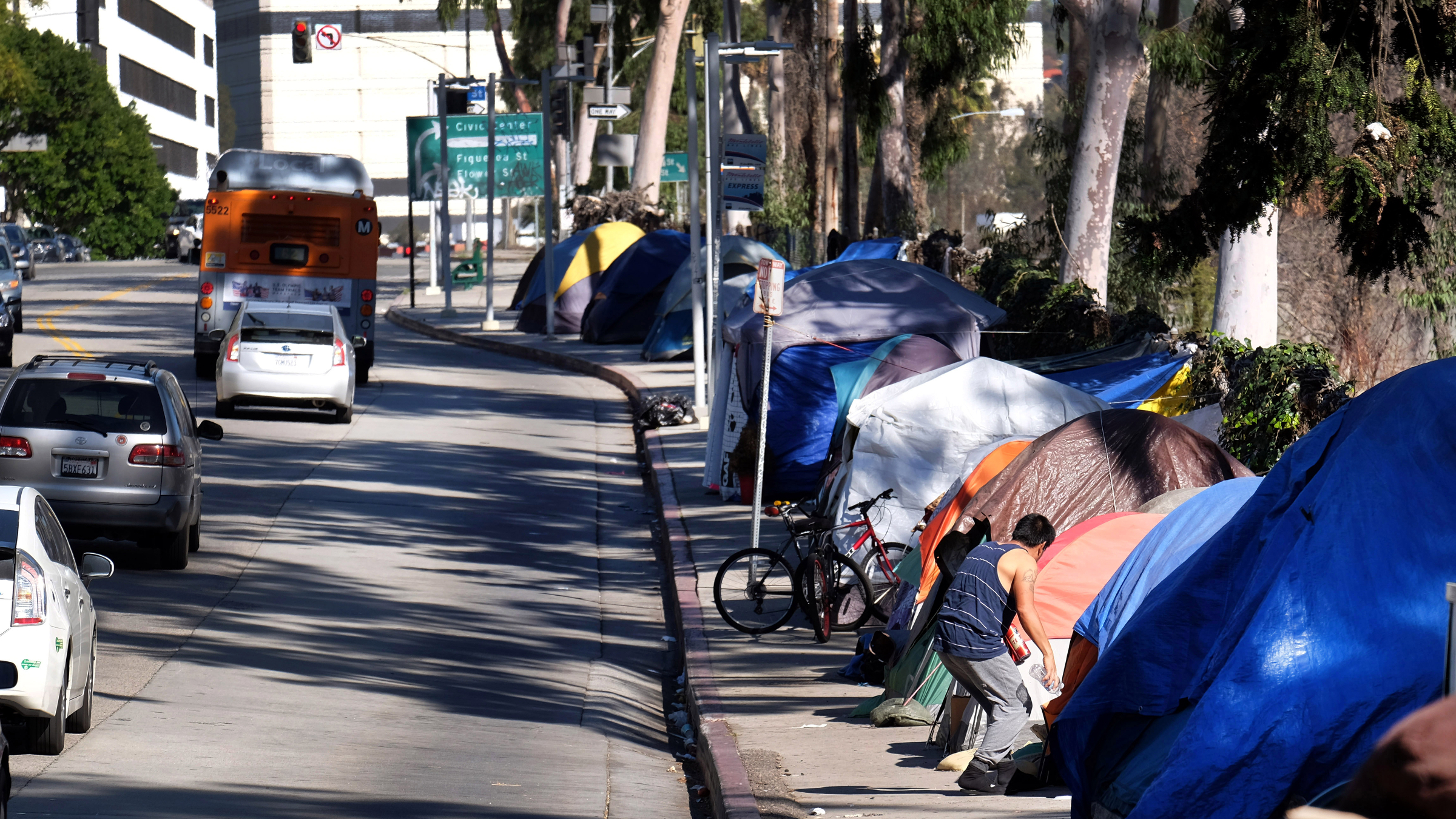 FILE - This Tuesday, Jan. 26, 2016 file photo shows tents from a homeless encampment line a street in downtown Los Angeles.With California's homeless situation at a crisis level, state officials are negotiating a plan to provide up to $2 billion to help cities build permanent shelters that would get mentally ill people off the street.
