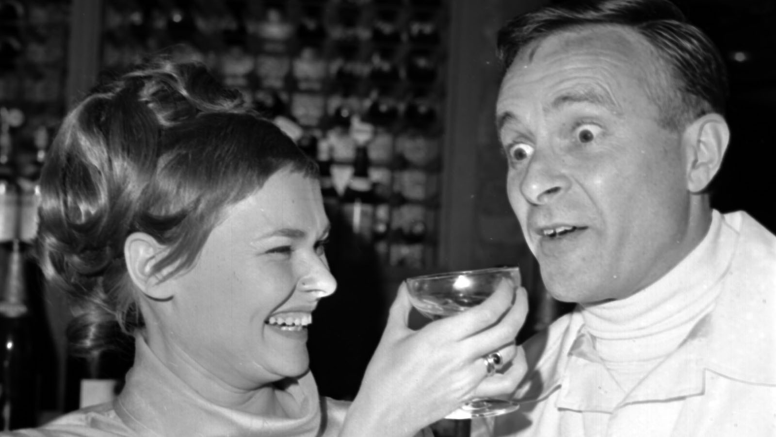 British actress Judi Dench, toasts British actor Alec McCowan,during a party held at the Mermaid Theatre, London, July 24, 1968. (AP Photo/Staff/Dear).