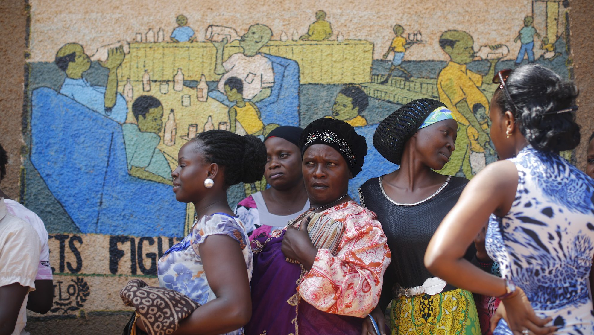 Women in Uganda wait in a line to cast their votes in a parliamentary election in February 2016.