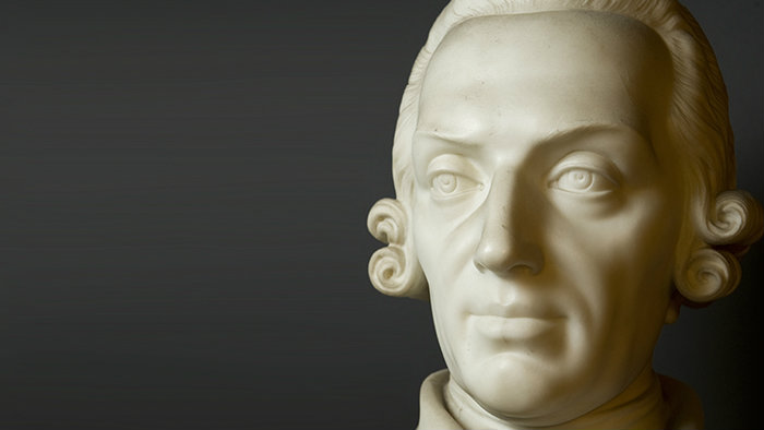 A sculptured bust of Adam Smith's head.