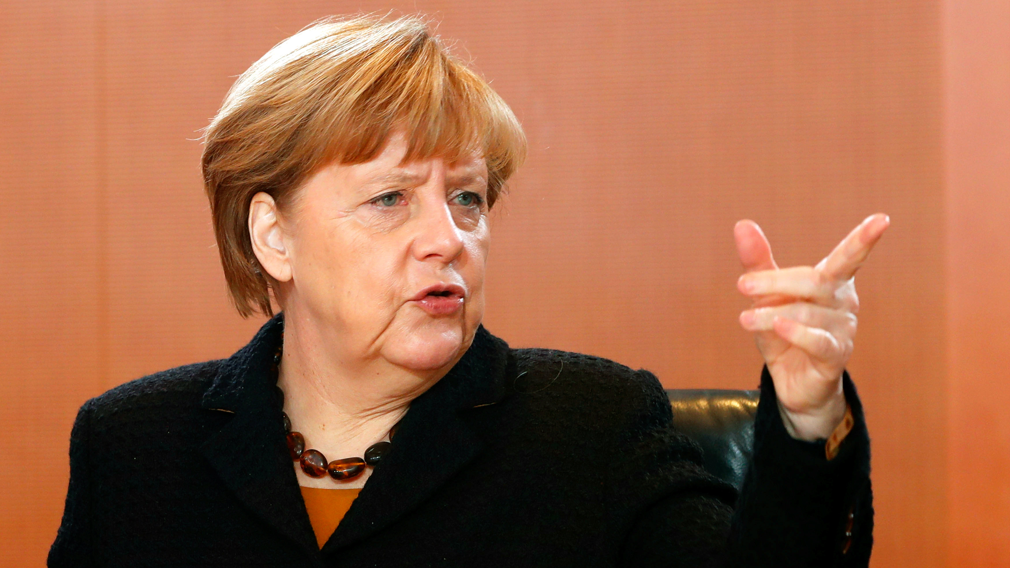 German chancellor Angela Merkel pointing.