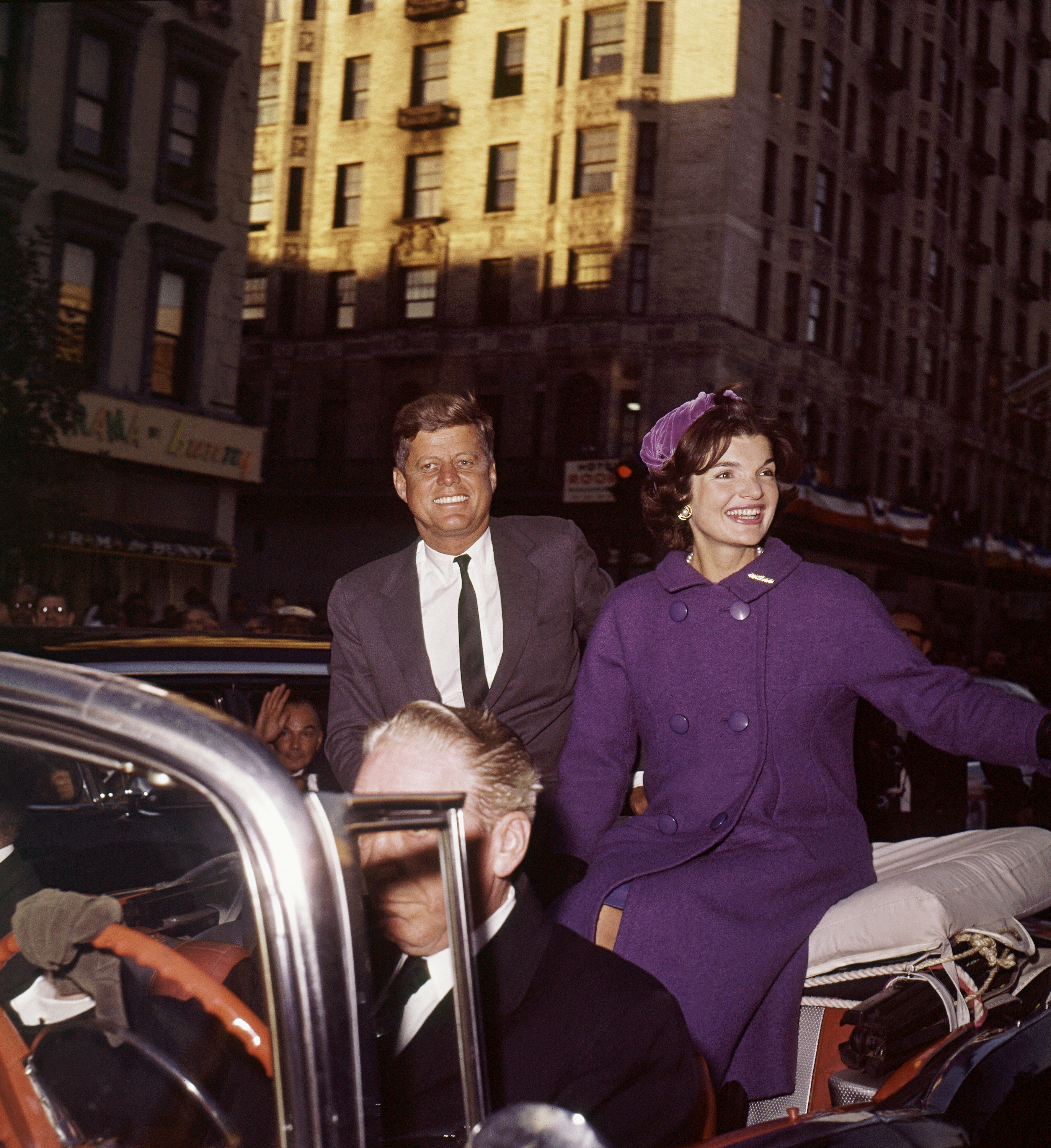 U.S. Senator John F. Kennedy, with wife Jacqueline, campaign in New York City sitting on the back seat of an open car, October 1960. Sen. Kennedy is the Democratic presidential candidate. (AP Photo)