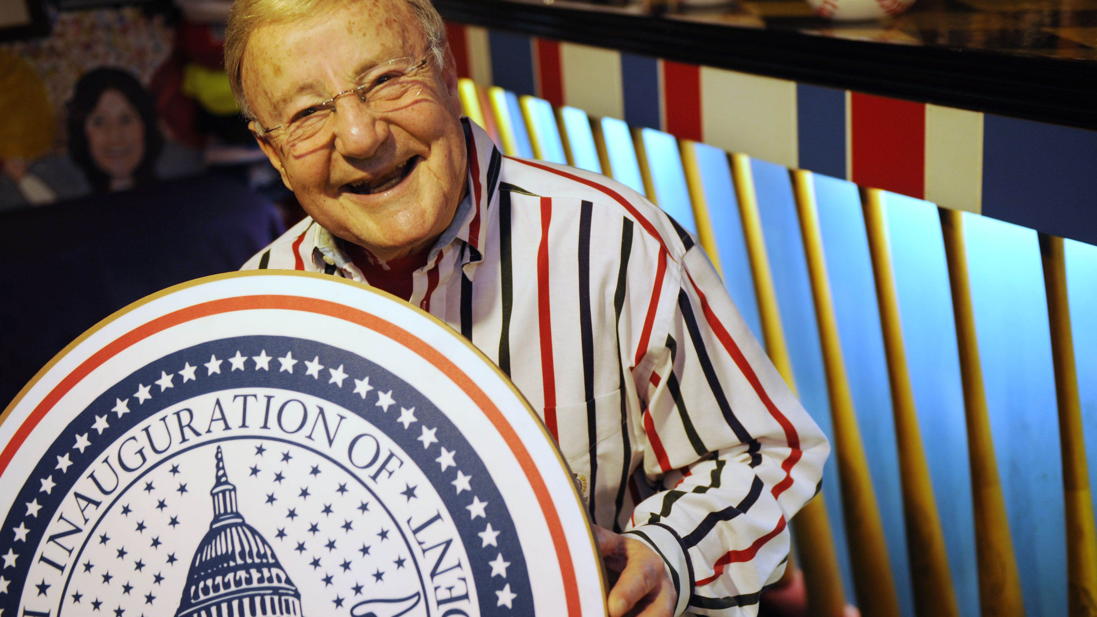 Charlie Brotman, 81, holds a large inaugural seal from 2005's inauguration, in his basement in Takoma Park, Md., Thursday, Jan. 8, 2009. Brotman has been an announcer at presidential inaugurations since 1957. (AP Photo/Jacquelyn Martin)