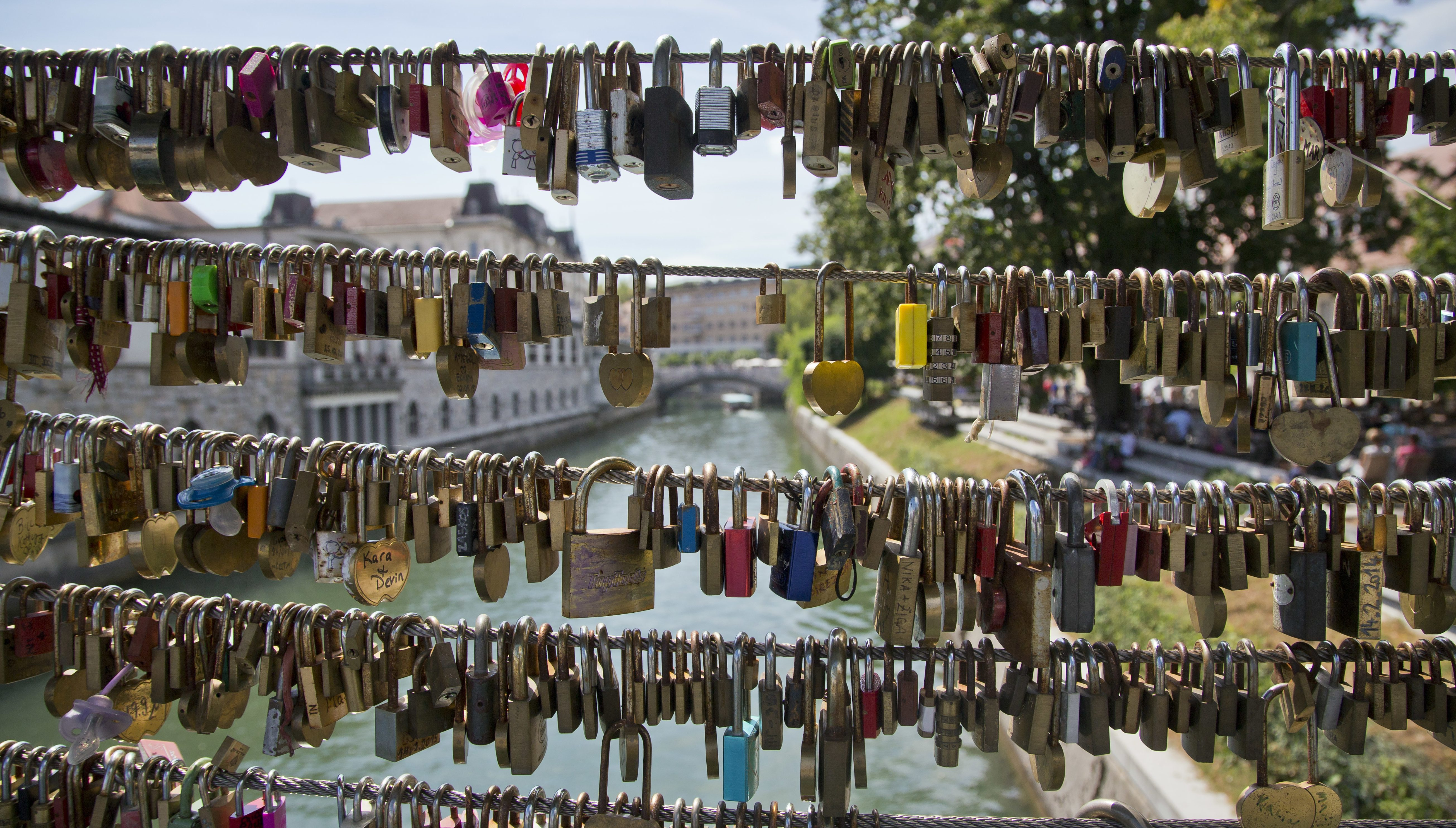 In this Aug. 12, 2016 photo, padlocks left by couples hang at a bridge in downtown Ljubljana, Slovenia. Over the past two decades since Melanija Knavs, who later changed her name to Melania Knauss, left her native Slovenia and married American billionaire Donald Trump after pursuing an international modeling career, Ljubljana has turned from a gray and drab place with almost no night life, into a lively and picturesque city filled with restaurants, cafes and night clubs packed with foreigners. (AP Photo/Darko Bandic)