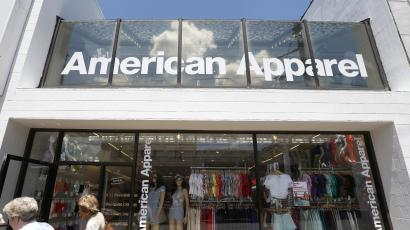 In this Wednesday, July 9, 2014, file photo, passers-by walk in front of the American Apparel store in the Shadyside neighborhood of Pittsburgh. American Apparel announced Monday, Nov. 14, 2016, that the company is filing for bankruptcy protection for the second time in just over a year, unable to find its footing after a contentious fight for control with founder Dov Charney. (AP Photo/Keith Srakocic, File)