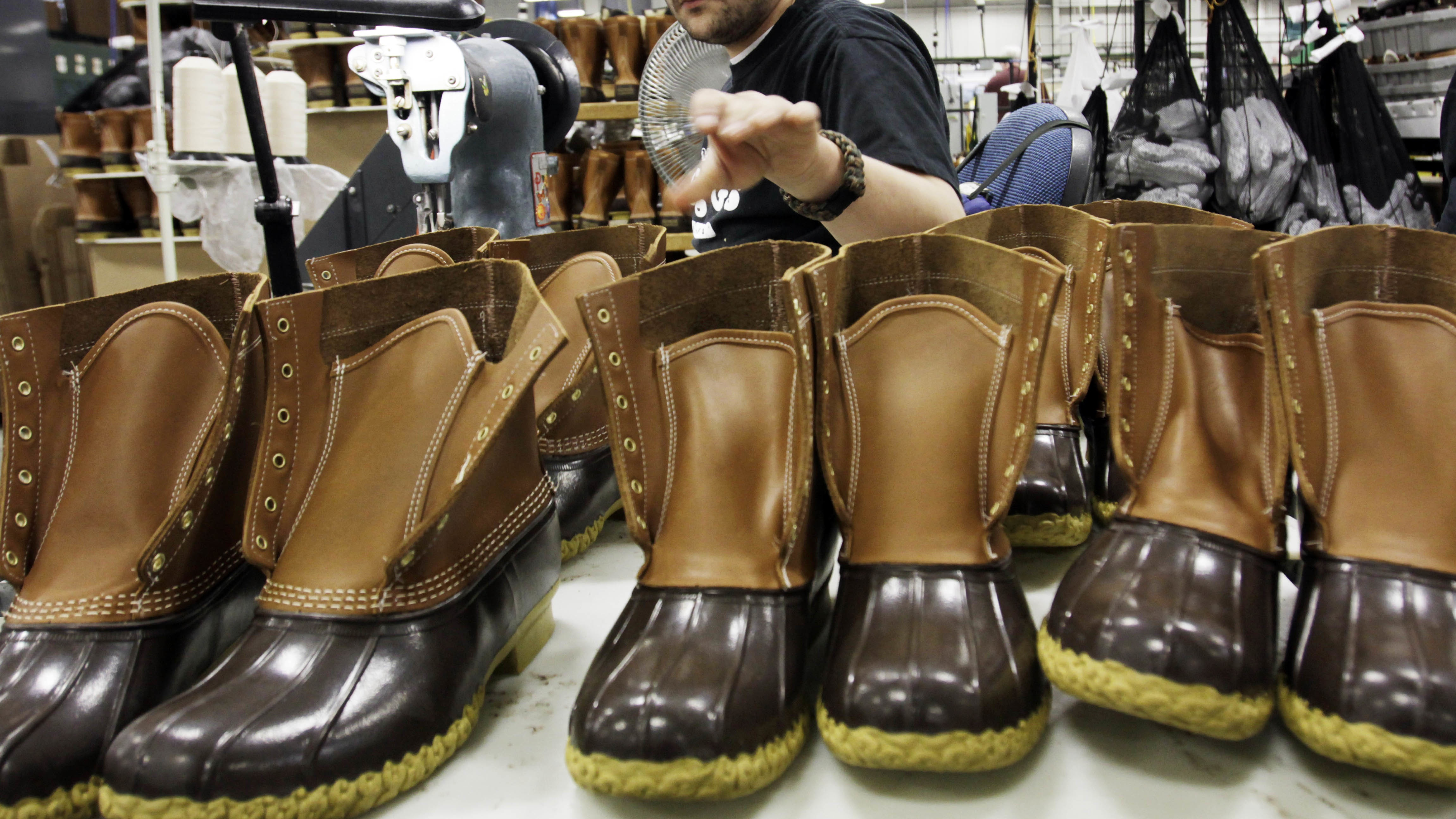 n this Dec. 14, 2011, file photo, Eric Rego stitches boots in the facility where LL Bean boots are assembled in Brunswick, Maine. L.L. Bean is kicking it up a notch as demand continues to surge for its iconic boot. The Maine-based outdoors retailer has leased a 110,000-square-foot building and plans to install a third injection-molding machine. The company is boosting production to meet demand that's expected to reach 1 million pairs in 2018. (AP Photo/Pat Wellenbach, File)