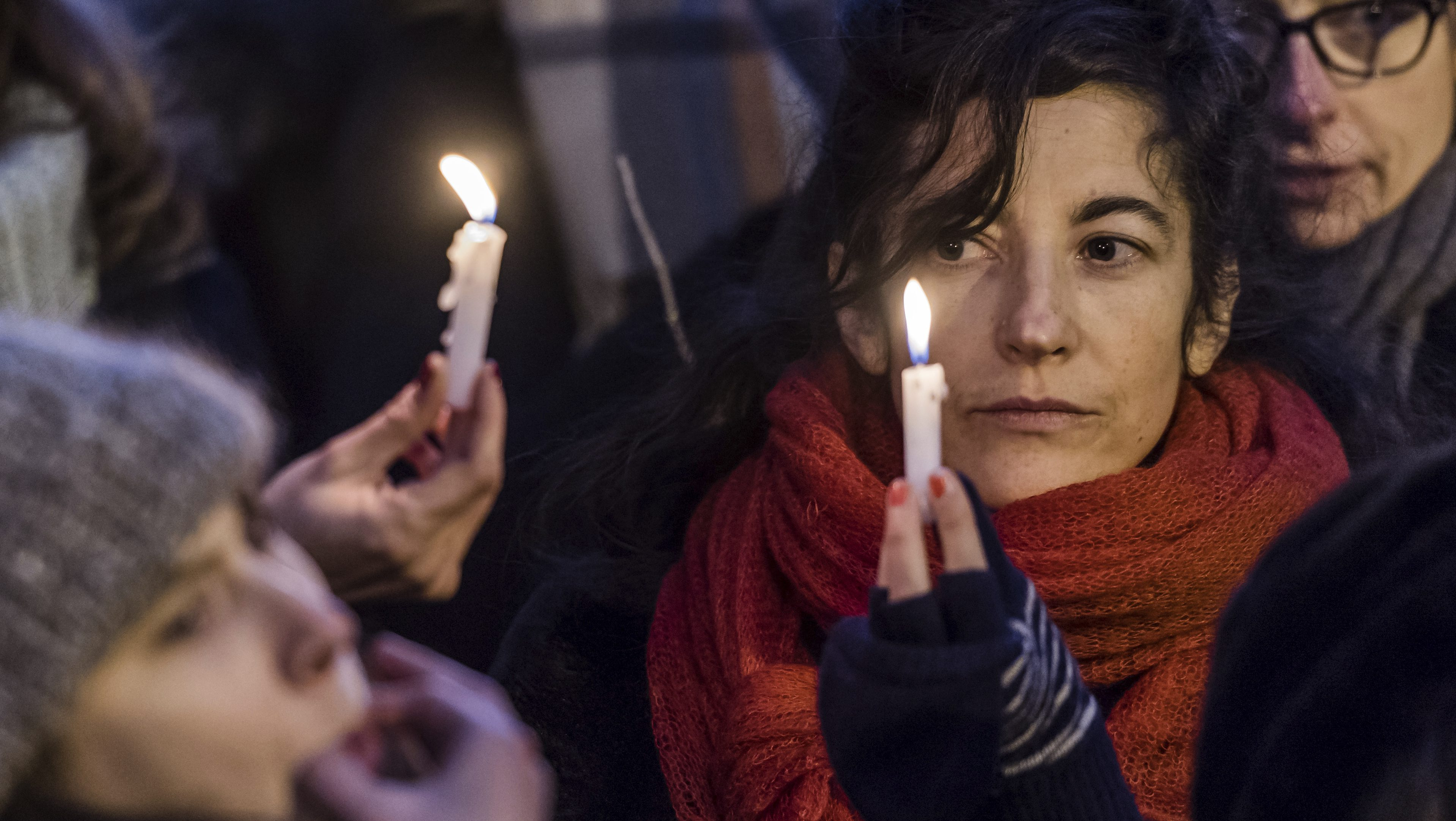 People light candles as they protest in solidarity with the Women's March in Washington at the same time as the U.S. Presidential inauguration, in Brussels on Friday, Jan. 20, 2017. The event organized by a multicultural grassroots coalition of women in the Brussels area seek to counter the rise of the far right agenda – be it in Europe, the U.S. or beyond. (AP Photo/Geert Vanden Wijngaert)