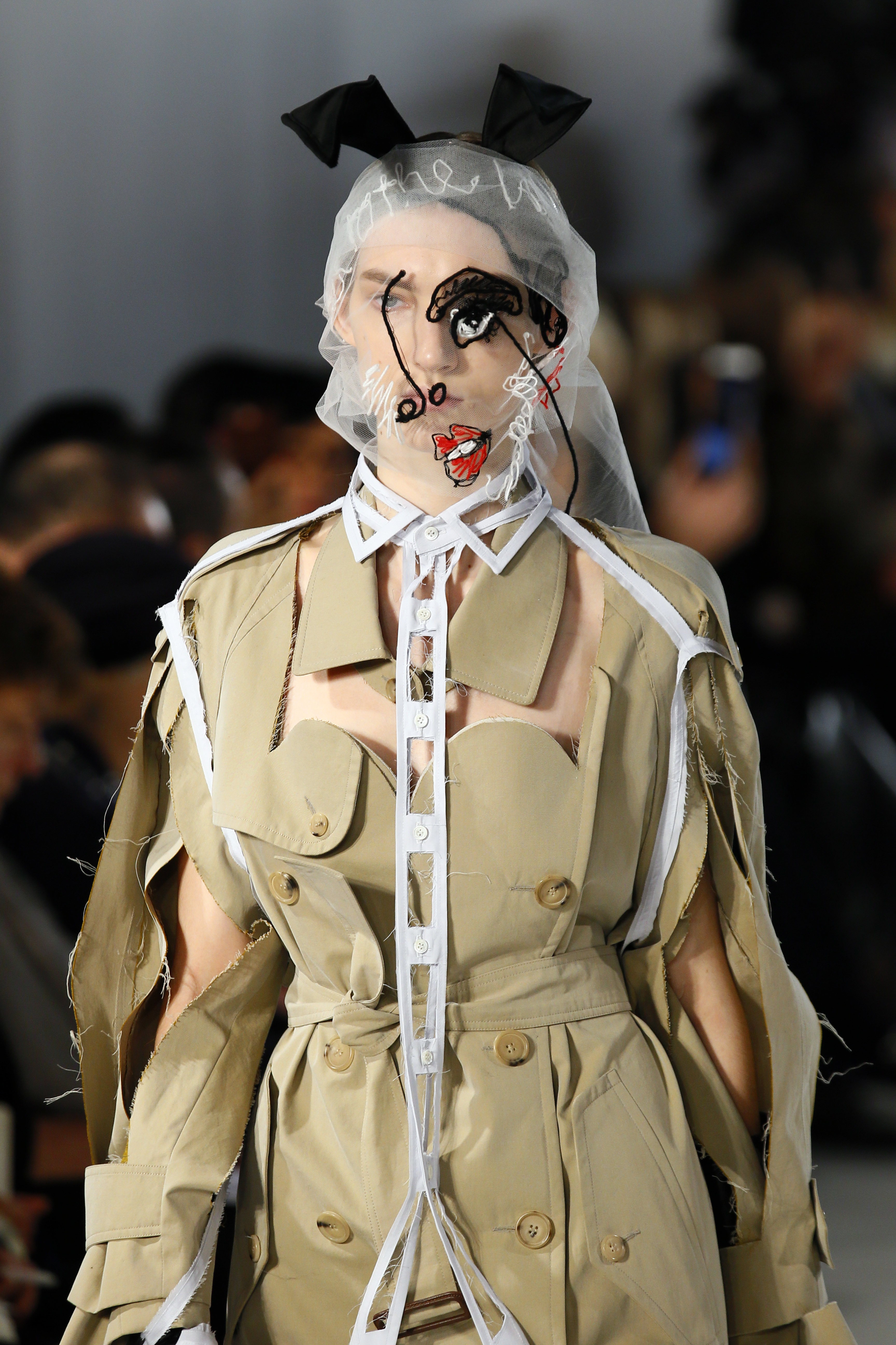 A model wears a creation for Maison Margiela's Haute Couture Spring-Summer 2017 fashion collection presented in Paris, Wednesday, Jan. 25, 2017. (AP Photo/Francois Mori)