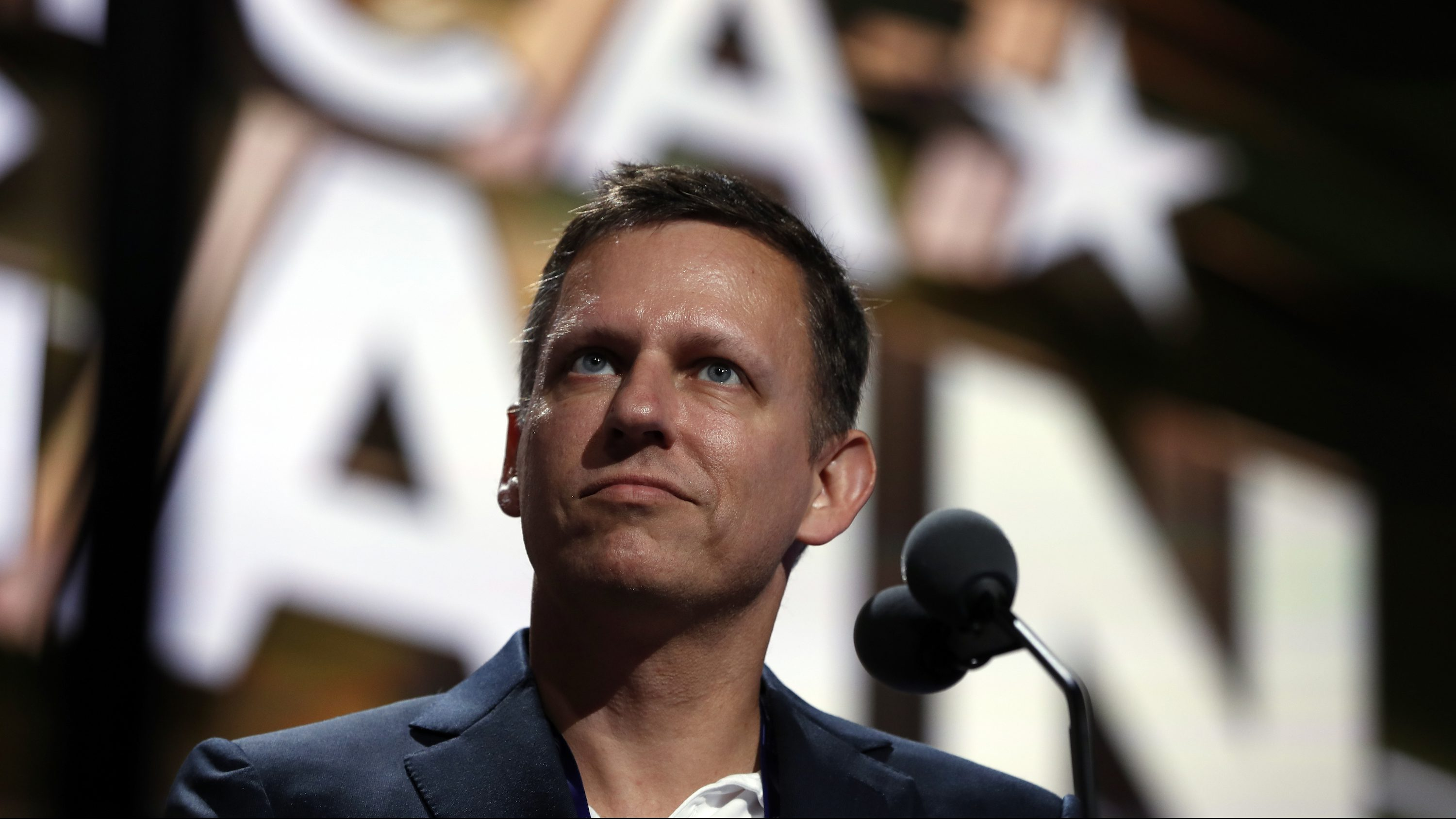 Billionaire tech investor Peter Thiels look over the podium before the start of the second day session of the Republican National Convention in Cleveland, Tuesday, July 19, 2016.