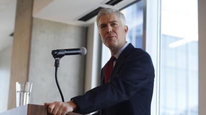 In this Friday, Jan. 27, 2017, photograph, 10th U.S. Circuit Court of Appeals Judge Neil Gorsuch makes a point while delivering prepared remarks before a group of attorneys at a luncheon in a legal firm in lower downtown Denver. (AP Photo/David Zalubowski)