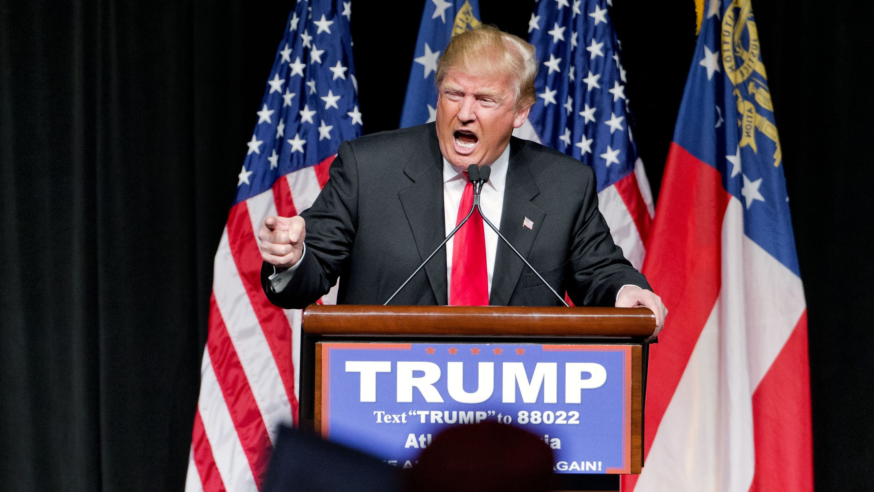 """In this Feb. 21, 2016, photo, Republican presidential candidate Donald Trump speaks at a campaign event in Atlanta. Trump has repeated inaccurate and racially-charged crime statistics, reposted pledges of support from white supremacists and retweeted dubious questions about the citizenship of his presidential rivals to an online following that includes more than six million people on Twitter alone. His response when challenged? To dismiss it all as nothing more than a harmless """"retweet."""" (AP Photo/David Goldman)"""