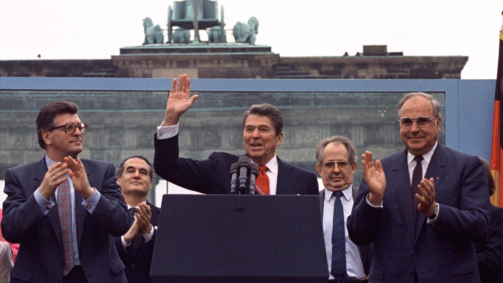 """** FILE ** In this June 12, 1987 file photo U.S. President Reagan acknowledges the crowd after his speech in front of the Brandenburg Gate in West Berlin,  where he said """"Mr. Gorbachev, tear down this wall!'. On Tuesday June 12, 2007, It will be the 20th anniversary of the moment seen by many to be the start of a new age for politics.  Applauding Reagan are West German Chancellor Helmut Kohl, right, and West German Parliament President Philipp Jenninger, left.   (AP PHOTO/Ira Schwartz)"""