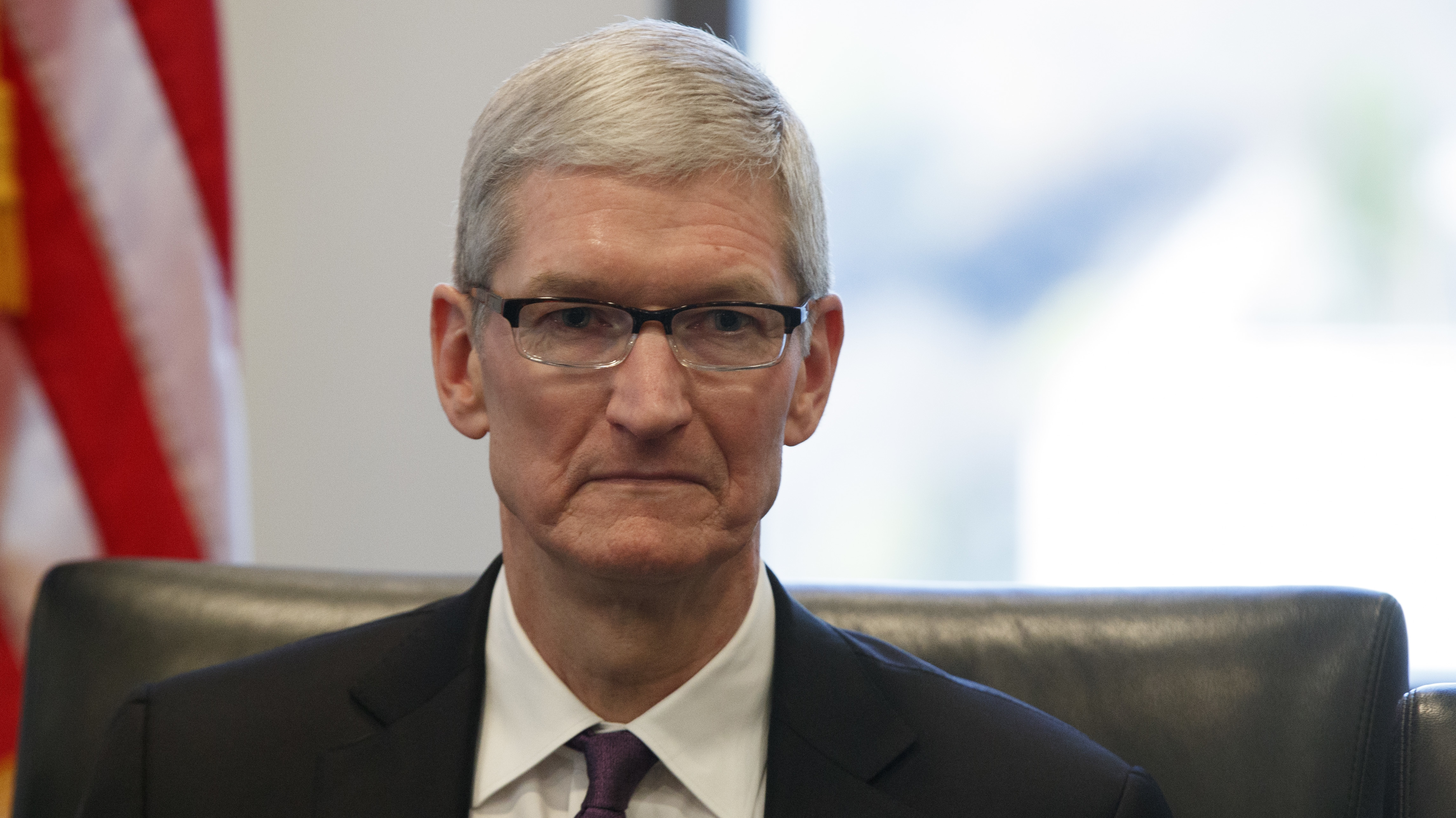 Apple CEO Tim Cook listens as President-elect Donald Trump speaks during a meeting with technology industry leaders at Trump Tower in New York, Wednesday, Dec. 14, 2016. (AP Photo/Evan Vucci)