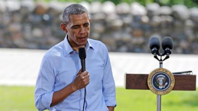 "President Barack Obama ponders a question as he holds a town hall meeting at Minnehaha Park, Thursday, June 26, 2014, in Minneapolis. Obama said that Washington needs to stop ""playing to the most fringe elements of politics"" and help Americans who are fighting to make ends meet, as he spent an afternoon with a working mother who wrote to him about her struggles. (AP Photo/Jim Mone)"