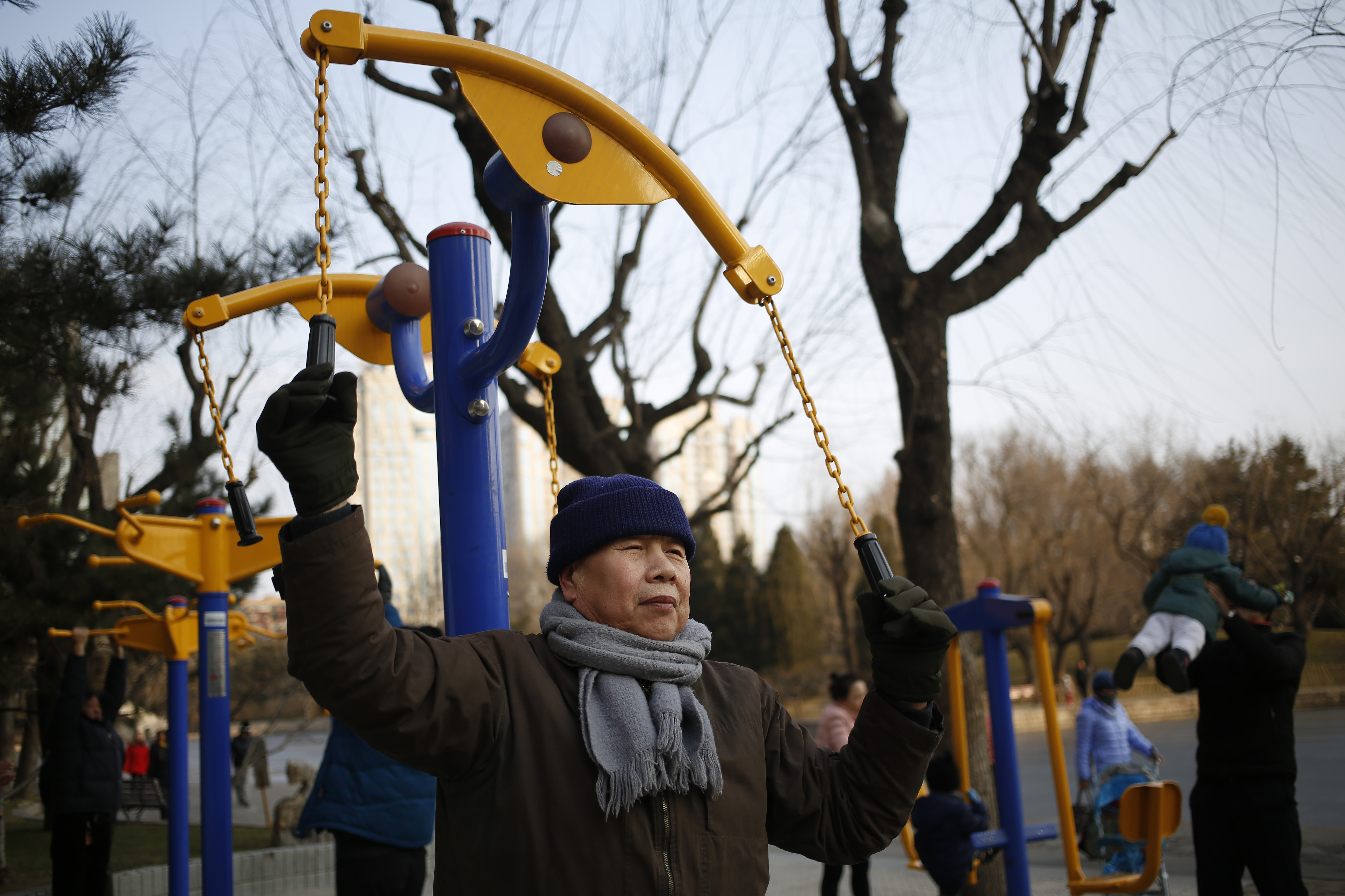 A Chinese elderly man exercising in a park on a clear day after the end of a long orange alert for smog in Beijing, China, 08 January 2017. People came out in droves to enjoy clean air and clear skies in Beijing after the end of an orange alert for heavy air pollution which lasted seven days, beginning on 02 January 2017. EPA/HOW HWEE YOUNG