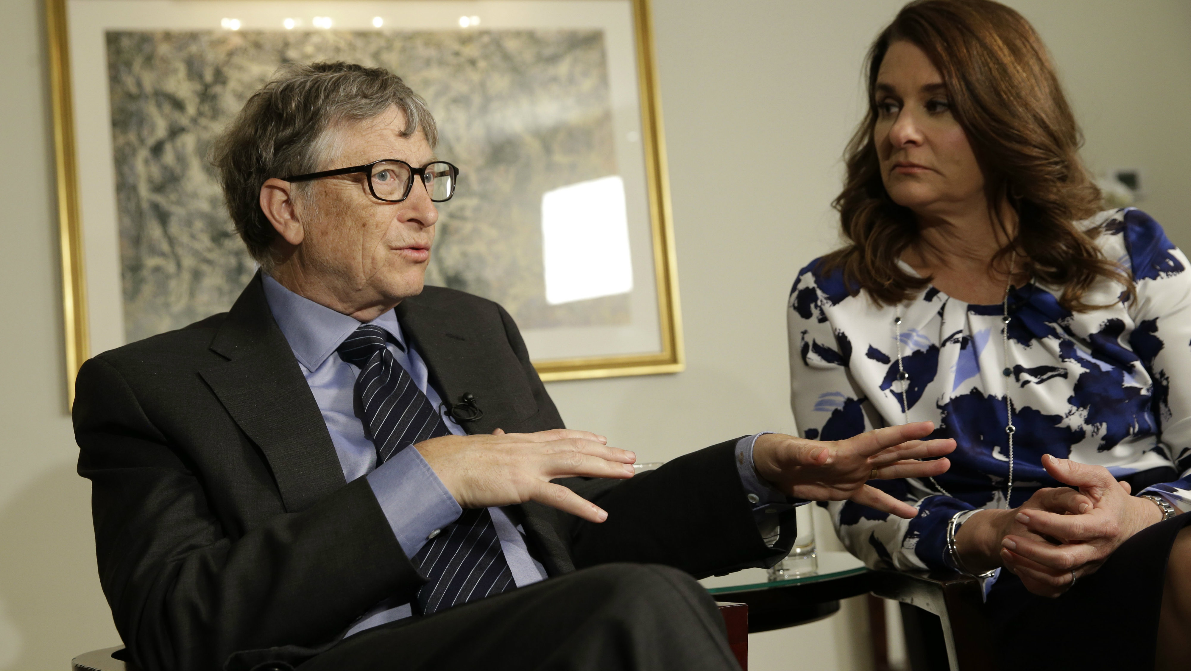 In this Monday, Feb. 22, 2016 file photo, Bill and Melinda Gates talk to reporters about the 2016 annual letter from their foundation, the Bill and Melinda Gates Foundation, in New York. Researchers are trying to infect mosquitoes in Brazil and Colombia with a type of bacteria that could prevent them from spreading Zika virus and other dangerous diseases. British and American governments are teaming up with the Bill and Melinda Gates Foundation and the U.K.-based Wellcome Trust to expand field tests in Rio de Janeiro in Brazil and the city of Bello in northwest Colombia, philanthropist Bill Gates told a conference Wednesday Oct. 26, 2016.