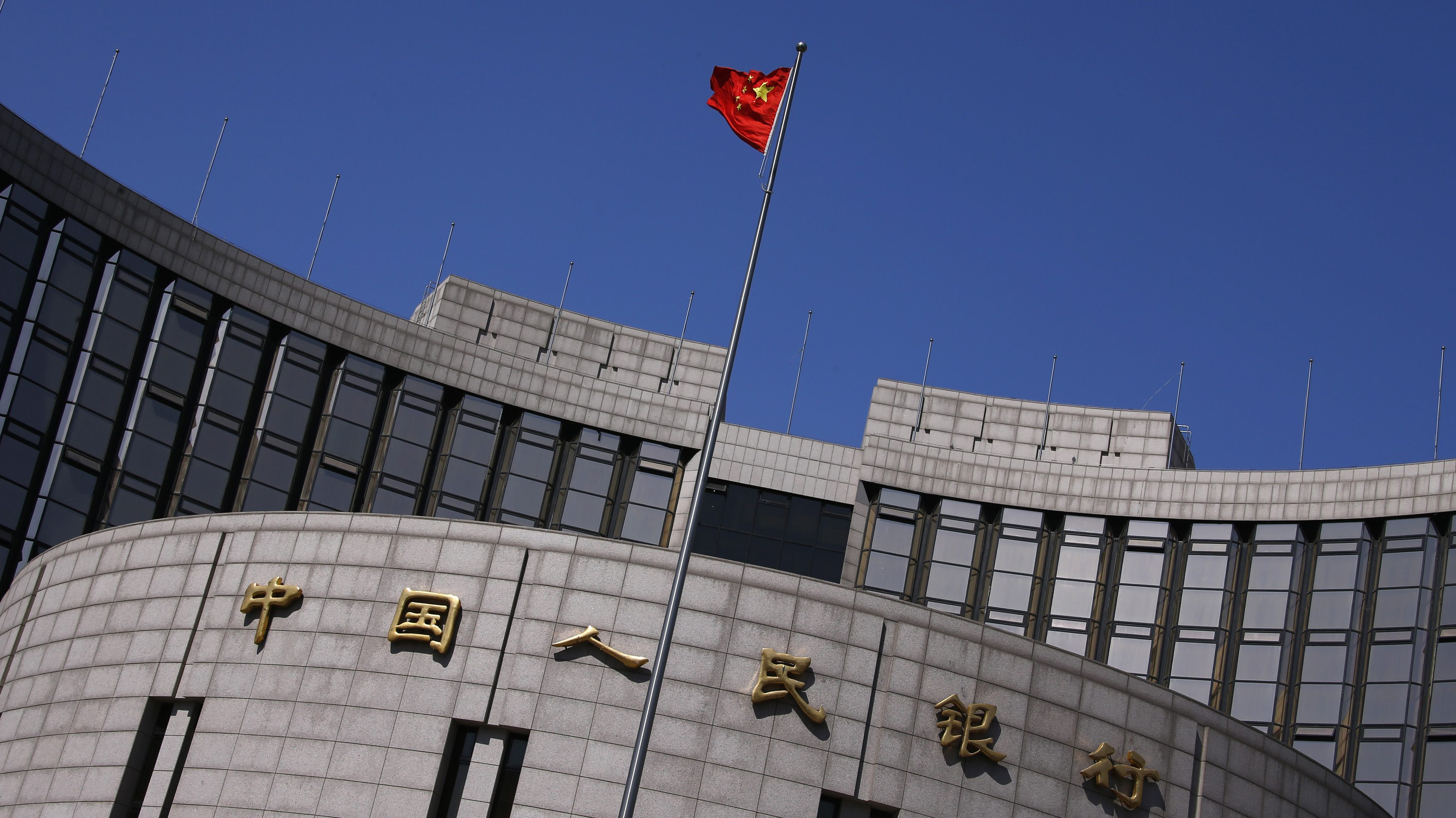 A Chinese national flag flutters outside the headquarters of the People's Bank of China, the Chinese central bank, in Beijing, April 3, 2014. Beijing's attack on yuan speculators has proven extraordinarily successful, so much so that traders no longer see it as a short-term intervention but a deeper market shift that has now gained a self-reinforcing momentum. That's bad news for speculators still holding onto bullish yuan positions. And for the People's Bank of China (PBOC), the risk is it has unleashed bearish forces it may not be able to rein in, souring enthusiasm for the yuan and complicating the push to increase the international adoption of the currency. To match Analysis CHINA-YUAN/    Picture taken April 3, 2014.