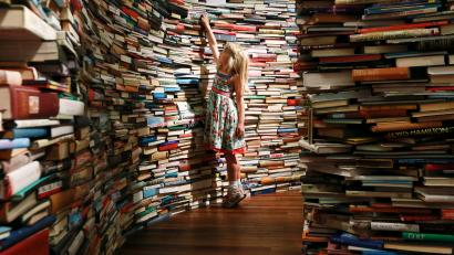 girl surrounded by stacks of books
