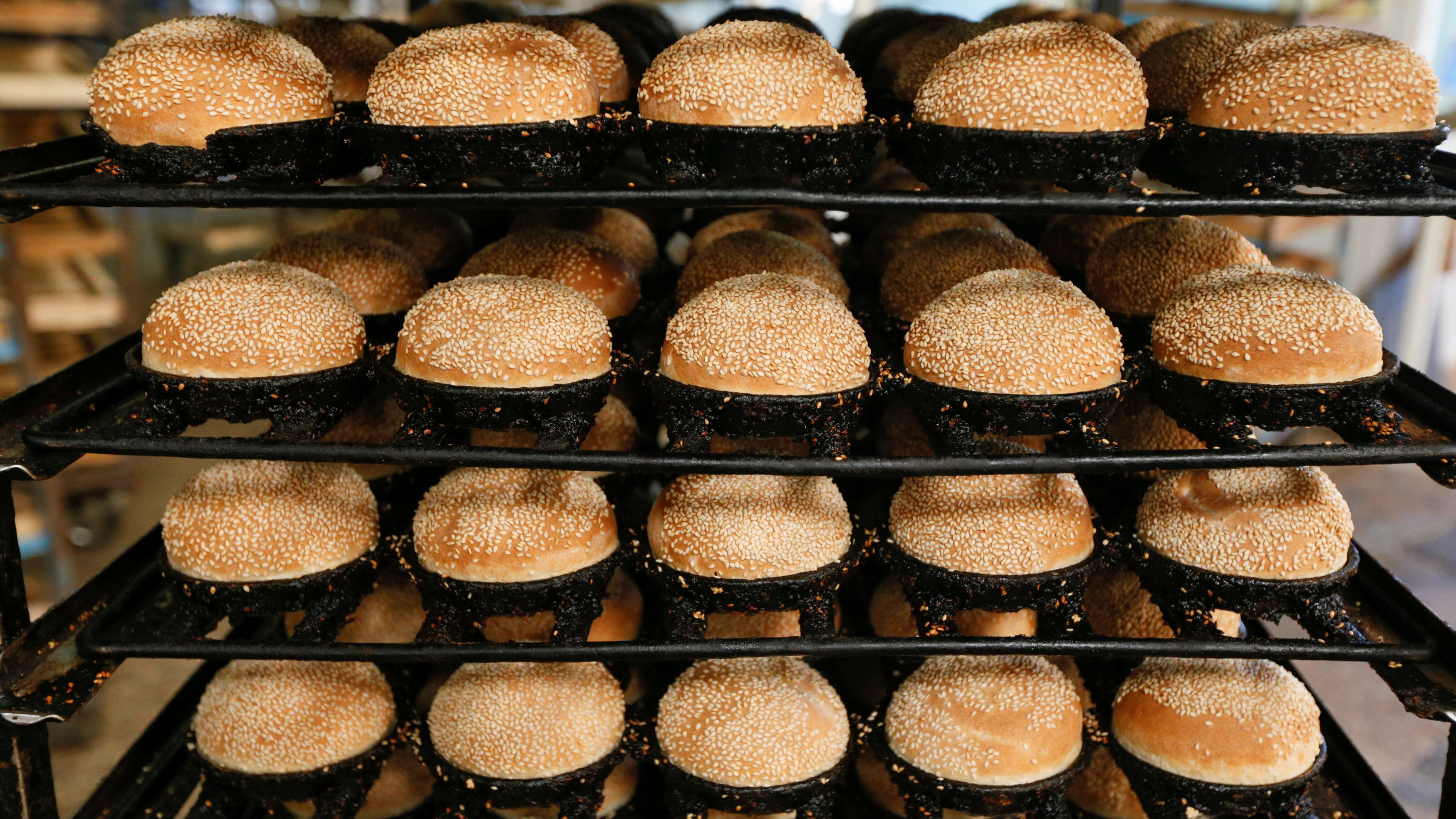 Freshly baked burger buns are stored on trays at a production facility of Kyivkhlib bakery in Kiev, Ukraine, August 25, 2016.