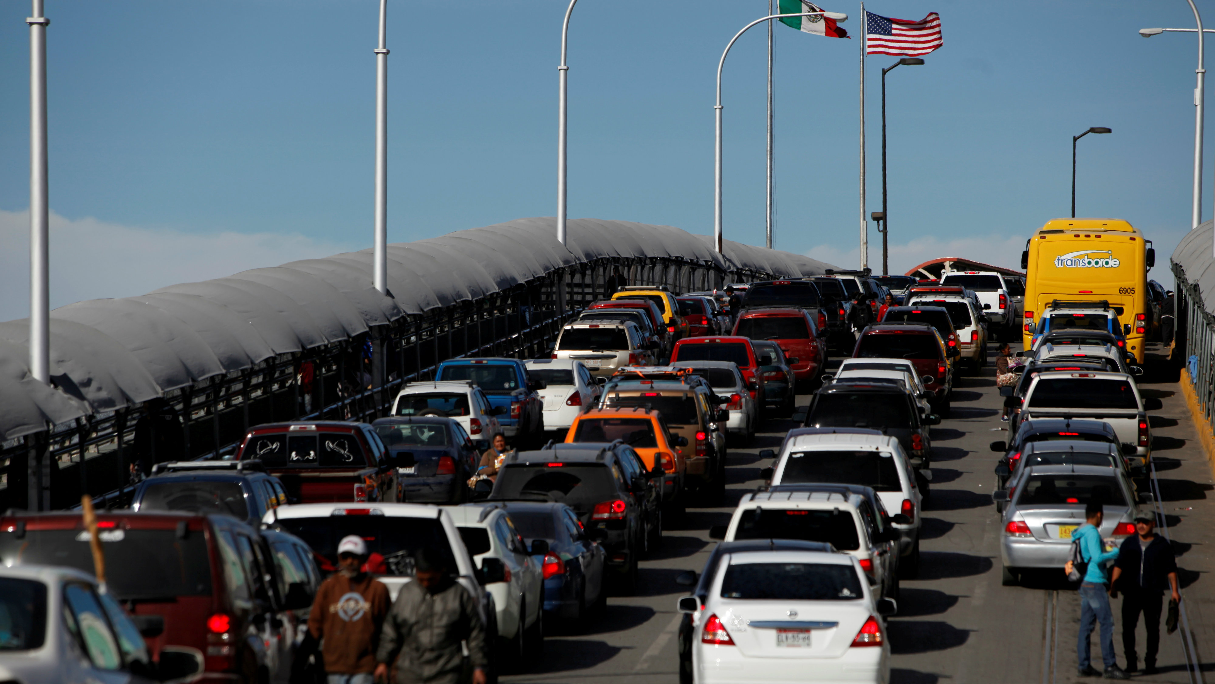 Cars wait to cross US-Mexico border