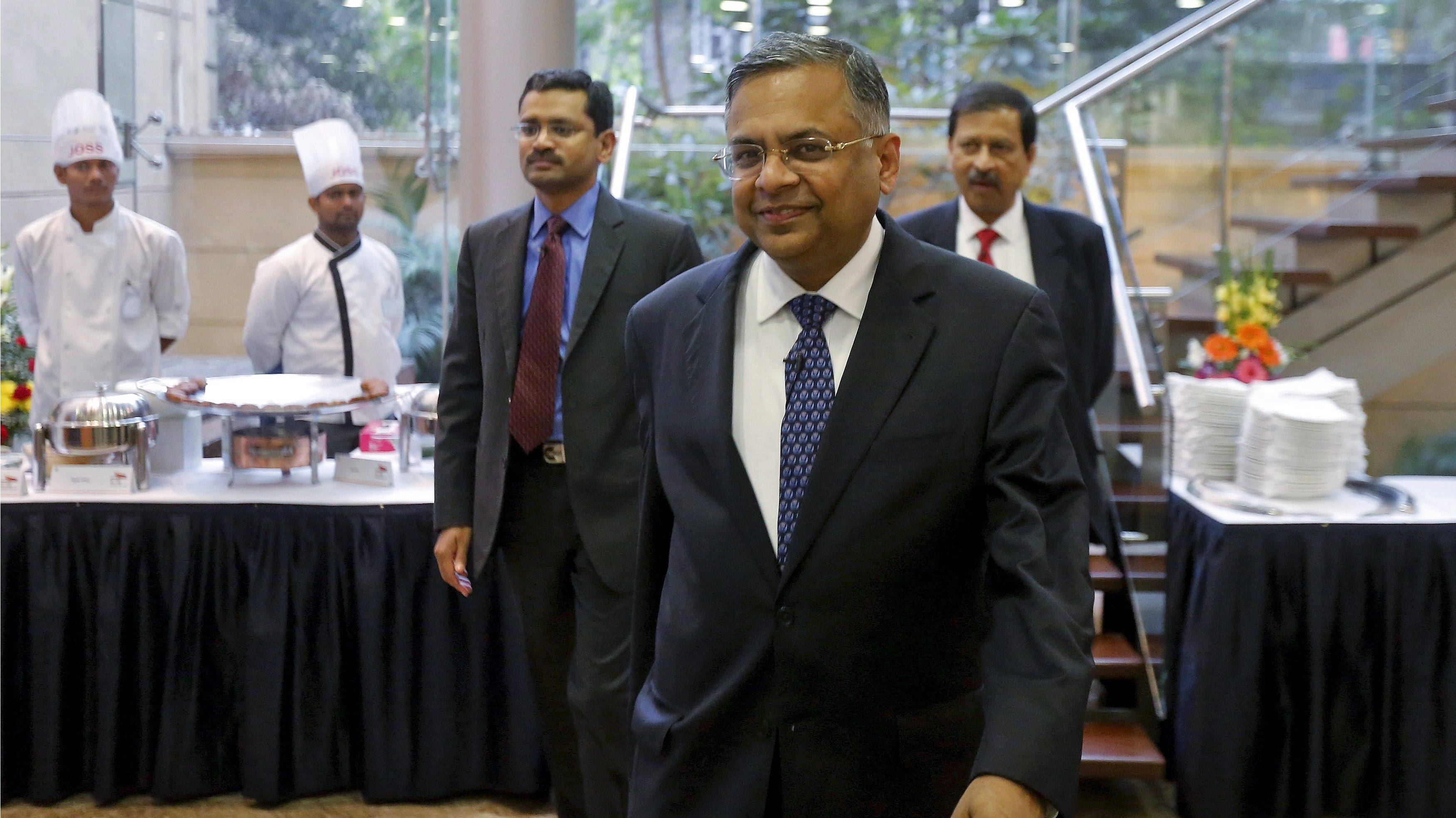 Tata Consultancy Services (TCS) Chief Executive N. Chandrasekaran arrives for a news conference in Mumbai, India, January 12, 2016. Tata Consultancy Services Ltd is eyeing acquisitions in Europe as well as healthcare technology companies in the U.S. to boost growth, Chandrasekaran said on Tuesday, as India's largest IT services exporter post a 12-percent rise in quarterly profit.