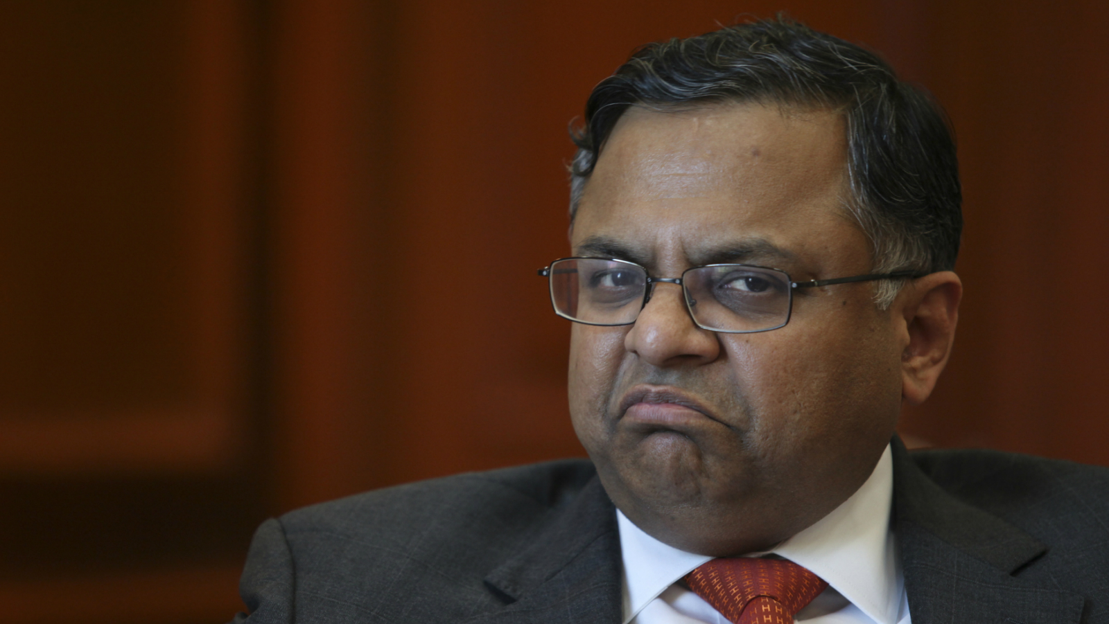 """Tata Consultancy Services (TCS) Chief Executive Officer N. Chandrasekaran gestures during an interview with Reuters in Mumbai January 18, 2012. TCS, India's largest software services exporter, has an order pipeline that is """"very healthy"""" across sectors, Chandrasekaran said in an interview on Wednesday. To match interview TATACONSULTANCY/"""