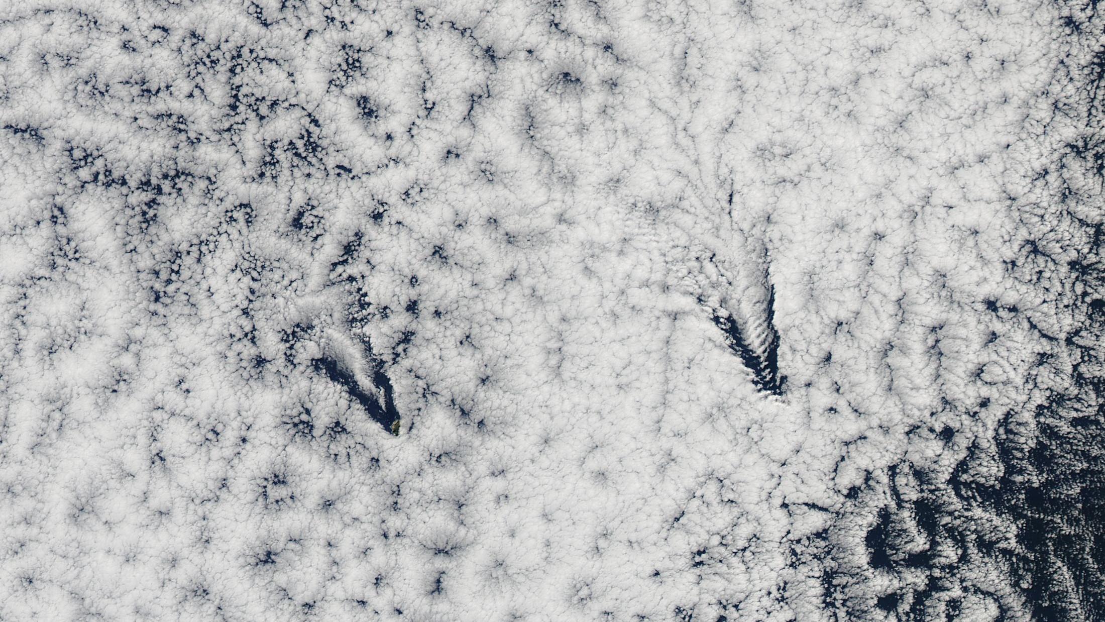 A view of the Juan Fernandez Islands cutting through the clouds, taken  700 km up.