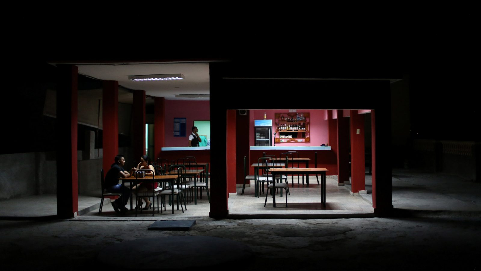 A couple sit in a bar in downtown Las Tunas, Cuba, October 1,