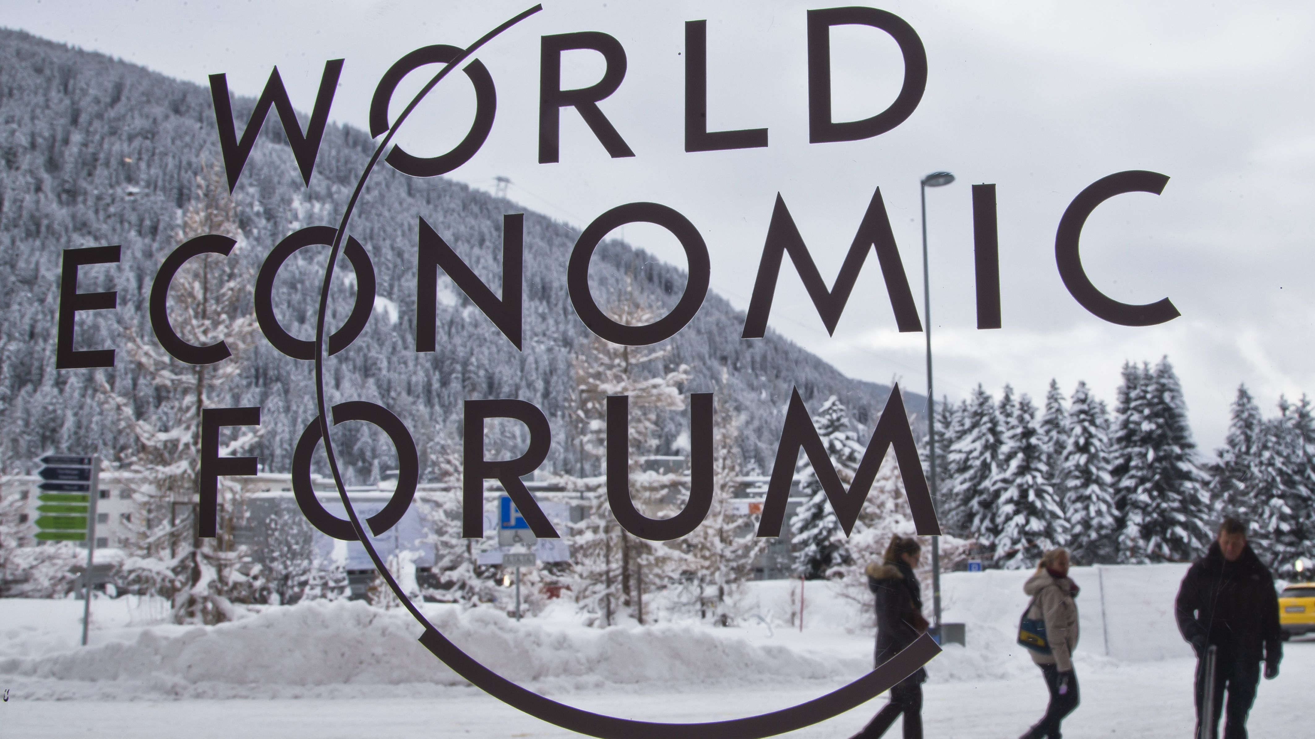 The logo of the World Economic Forum is visible through a window at the congress center where the annual meeting will take place in Davos, Switzerland, Sunday Jan. 15, 2017. Business and world leaders are gathering for the annual meeting in Davos. (AP Photo/Michel Euler)