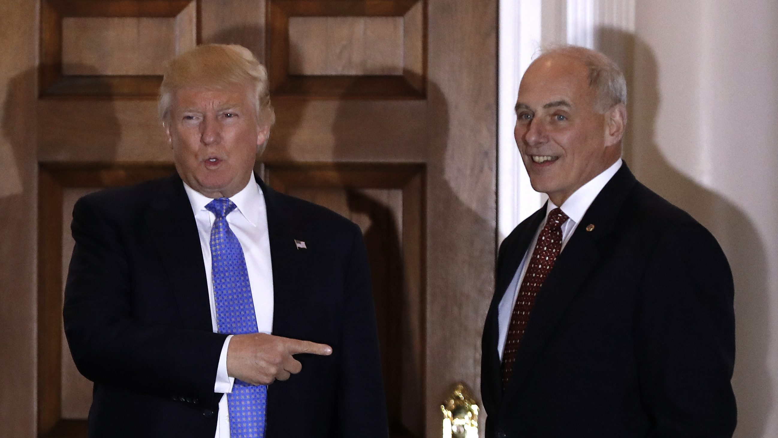President-elect Donald Trump talks to media as he stands with  retired Marine Gen. John Kelly