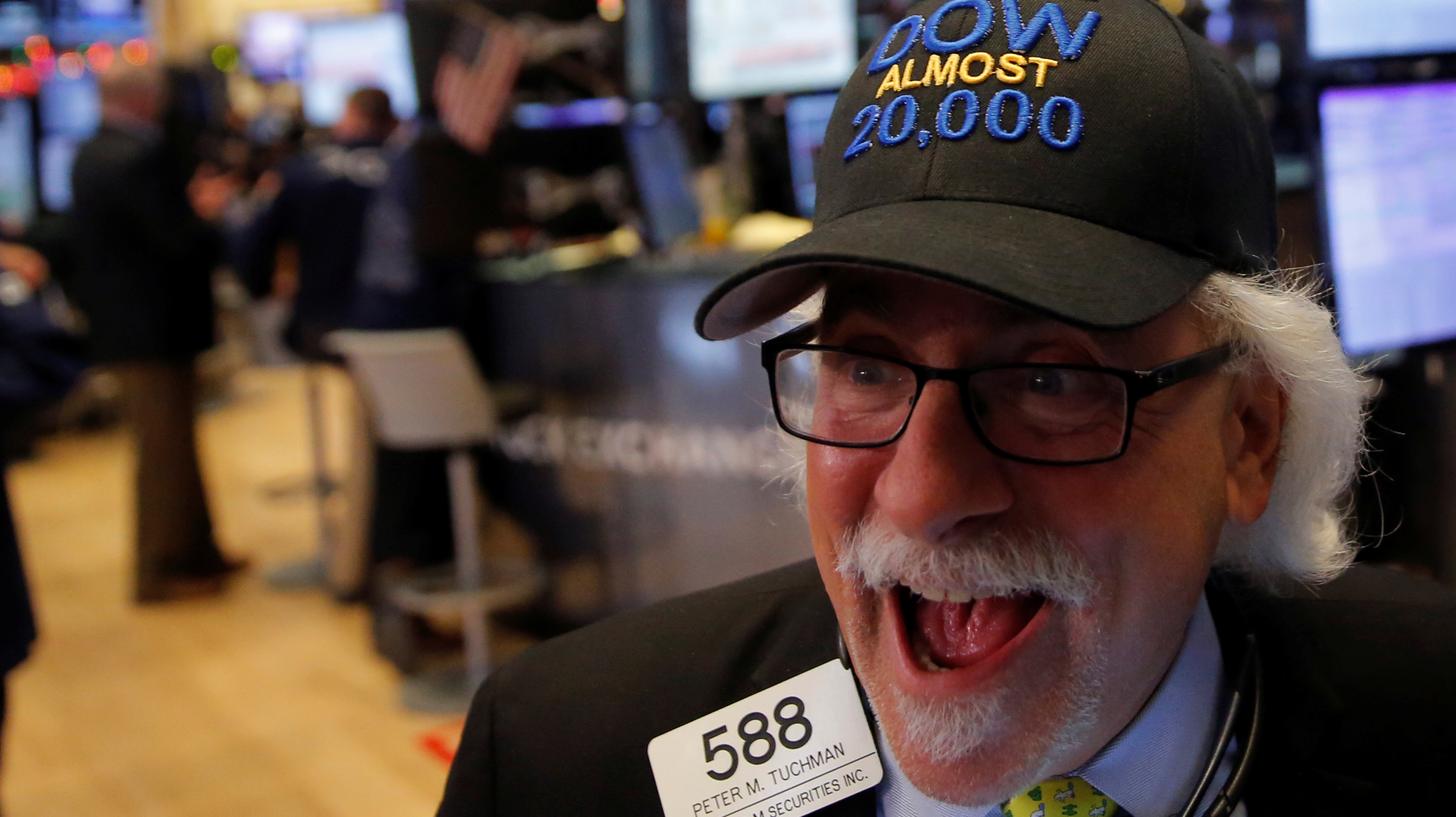 New York Stock Exchange trader gets excited about the Dow Jones almost reaching 20,000