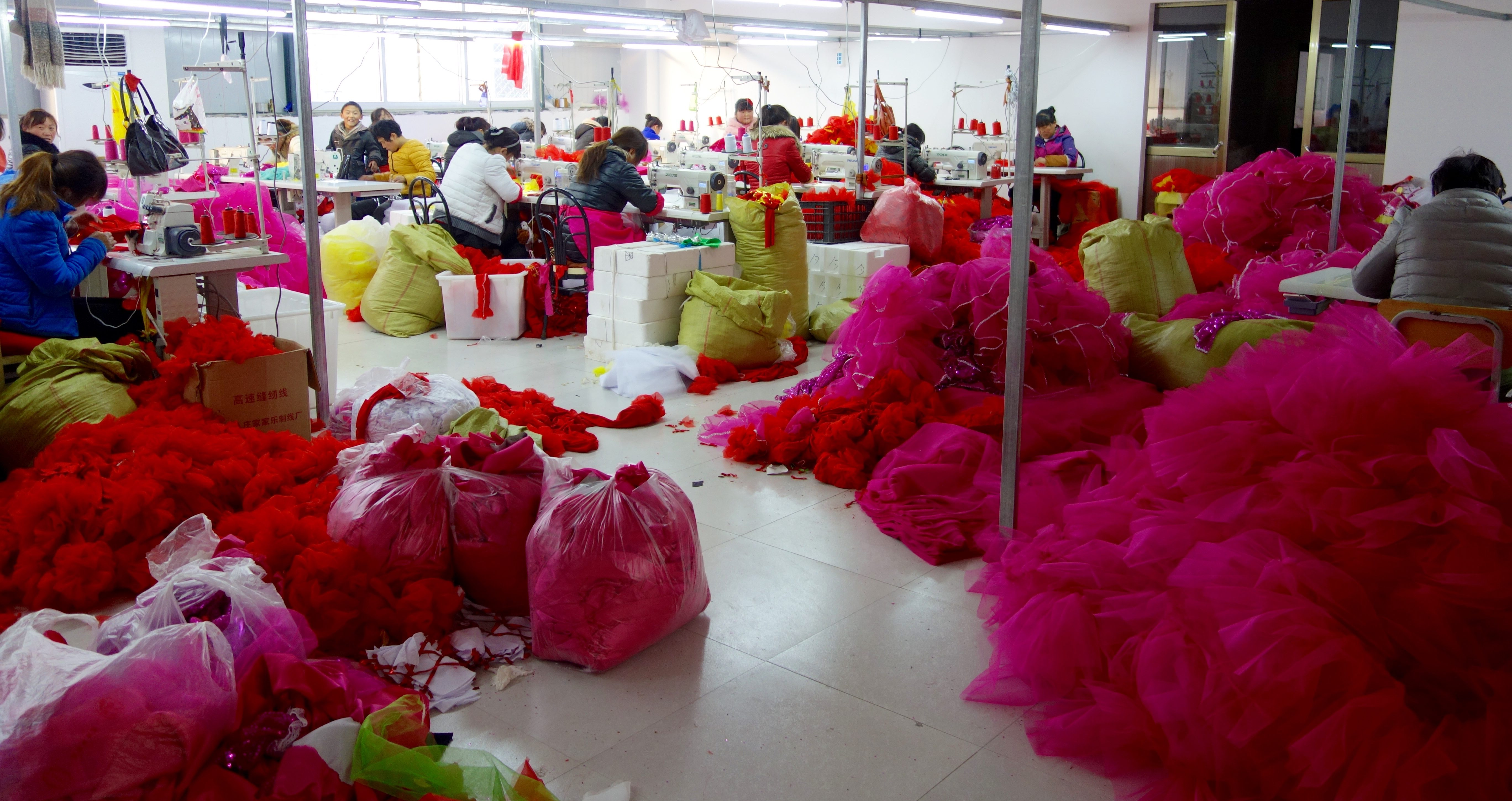 Women from nearby villages sew dance costumes in one of Daiji's new industrial parks built by the local government to house Taobao businesses.