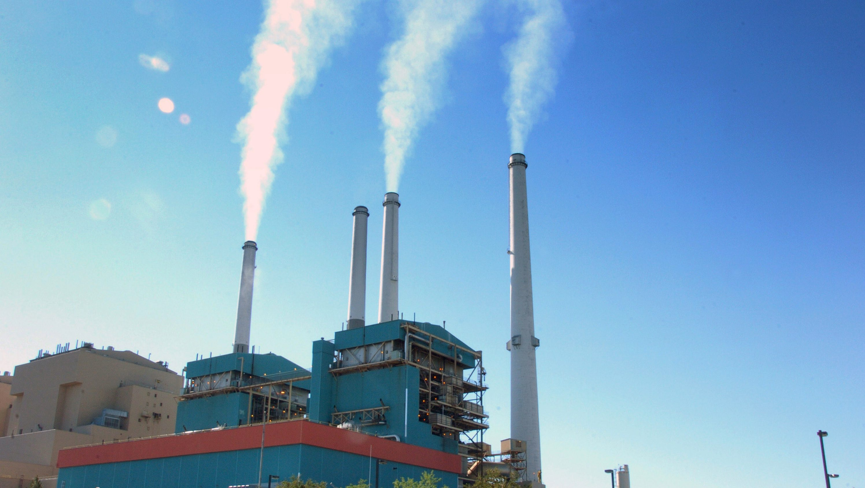 In this July 1, 2013, file photo, smoke rises from the Colstrip Steam Electric Station, a coal burning power plant in Colstrip, Mont.