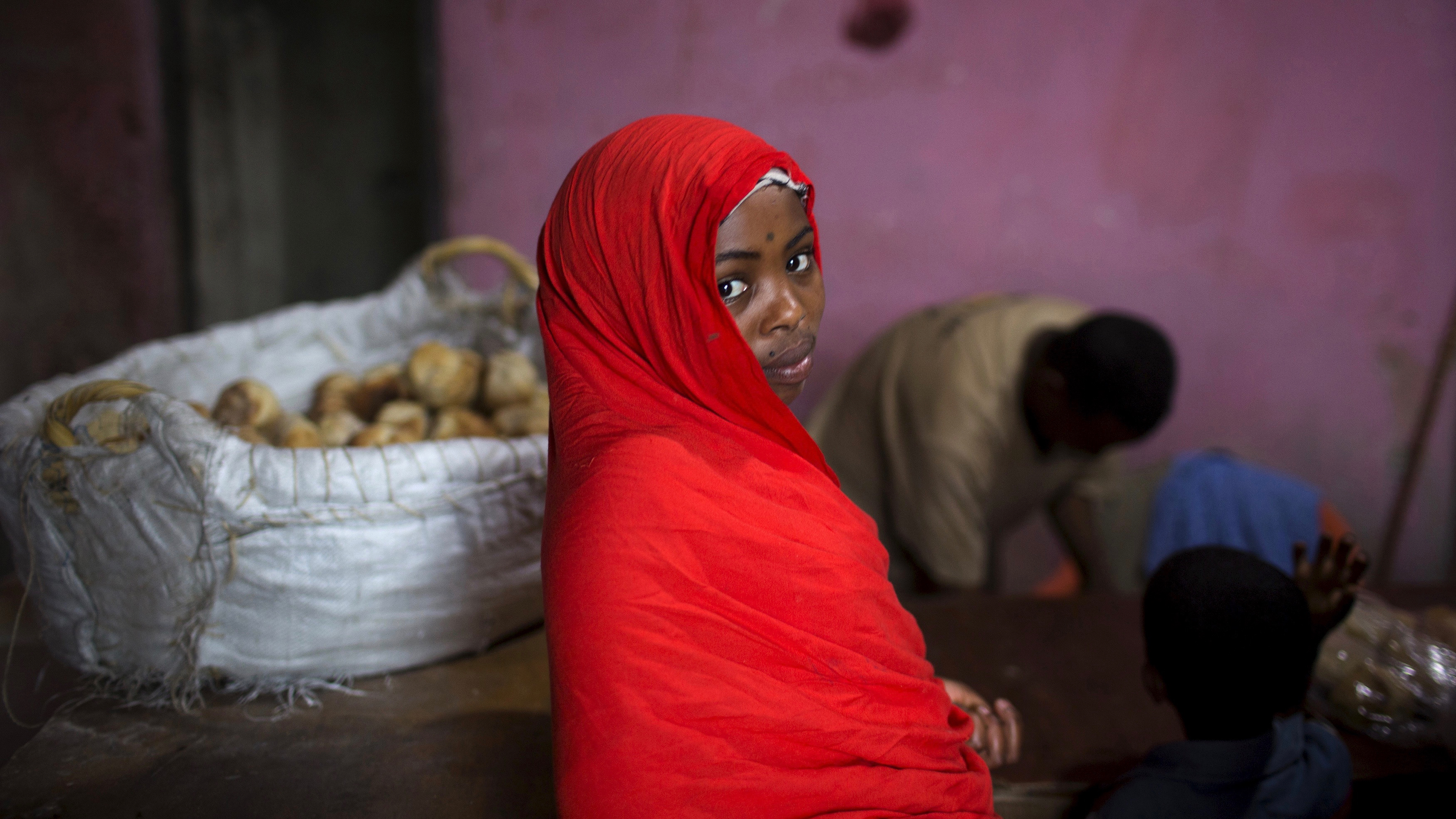 "A girl is seen in a bakery in the old walled town of Harar in eastern Ethiopia, May 19, 2015. Daily life of people in Ethiopia, where elections are held this weekend, is portrayed in the east African nation's churches and mosques, coffee shops and markets, both in the capital Addis Ababa and the walled town of Harar in the east. Ethiopia, home to nearly 100 million people, holds the first poll on Sunday since long-serving leader Meles Zenawi died in 2012. REUTERS/Siegfried Modola  PICTURE 26 OF 32 FOR WIDER IMAGE STORY ""SOCIETY AND FAITH IN ETHIOPIA"" SEARCH ""MODOLA FAITH"" FOR ALL IMAGES - RTX1E4LP"