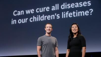 """Facebook CEO Mark Zuckerberg, left, smiles next to his wife Priscilla Chan as they rehearse for a speech in San Francisco, Tuesday, Sept. 20, 2016. Zuckerberg and Chan have a new lofty goal: to cure, manage or eradicate all disease by the end of this century. To this end, the Chan Zuckerberg Initiative, the couple's philanthropic organization, is committing $600 million over the next 10 years to build and run a """"Biohub"""" research center. (AP Photo/Jeff Chiu)"""