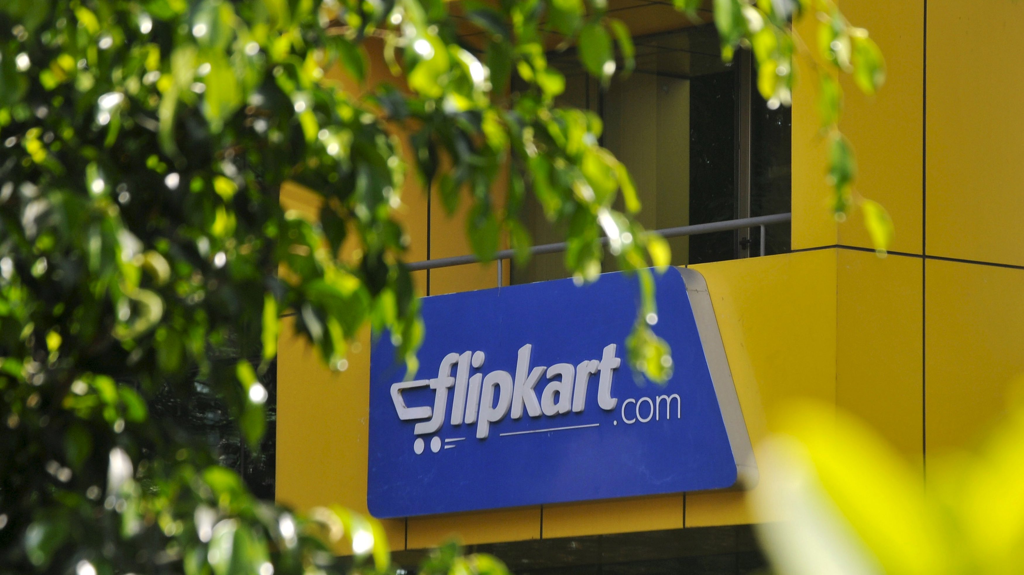 The logo of India's largest online marketplace Flipkart is seen on a building in Bengaluru, India, April 22, 2015. After losing top engineering talent for years to America's tech heartland of Silicon Valley, India is luring them back as an e-commerce boom sparks a thriving start-up culture, unprecedented pay, and perks including free healthcare for in-laws. Picture taken April 22, 2015. To match INDIA-ECOMMERCE/WORKERS.